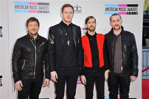 From left, Ben McKee, Dan Reynolds, Wayne Sermon, and Daniel Platzman of the musical group Imagine Dragons arrive at the American Music Awards.