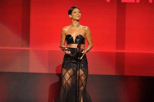 Rihanna accepts the award for favorite female artist - soul/R&B at the American Music Awards.