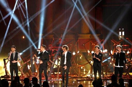 From left, Zayn Malik, Liam Payne, Harry Styles, Louis Tomlinson, and Niall Horan of the musical group One Direction perform on stage at the American Music Awards.