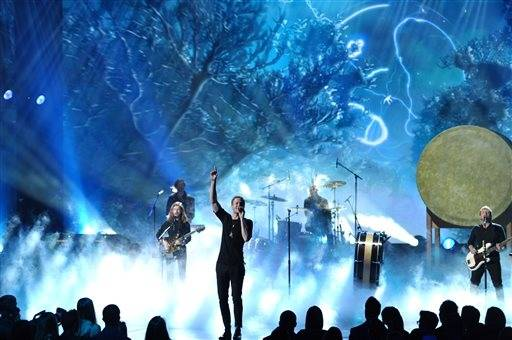 Dan Reynolds of the musical group Imagine Dragons performs on stage at the American Music Awards.