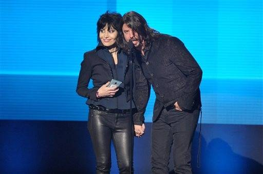 Dave Grohl of Foo Fighters and Joan Jett present an award during the AMAs.