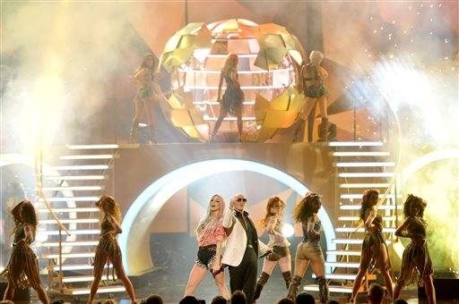 Ke$ha and Pitbull perform during the AMAs.
