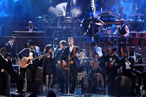 Justin Timberlake shows off another skill - guitar playing - during his performance on the AMAs.
