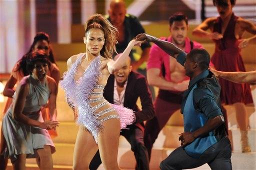 "Singer and returning ""American Idol"" judge Jennifer Lopez shows off her dancing skill during her AMA performance."