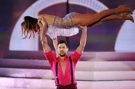 "Former ""Dancing with the Stars"" dancer Maksim Chmerkovskiy gives Jennifer Lopez a lift during the AMAs."