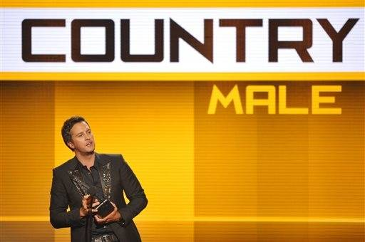 Luke Bryan accepts the award for favorite male artist - country at the American Music Awards.