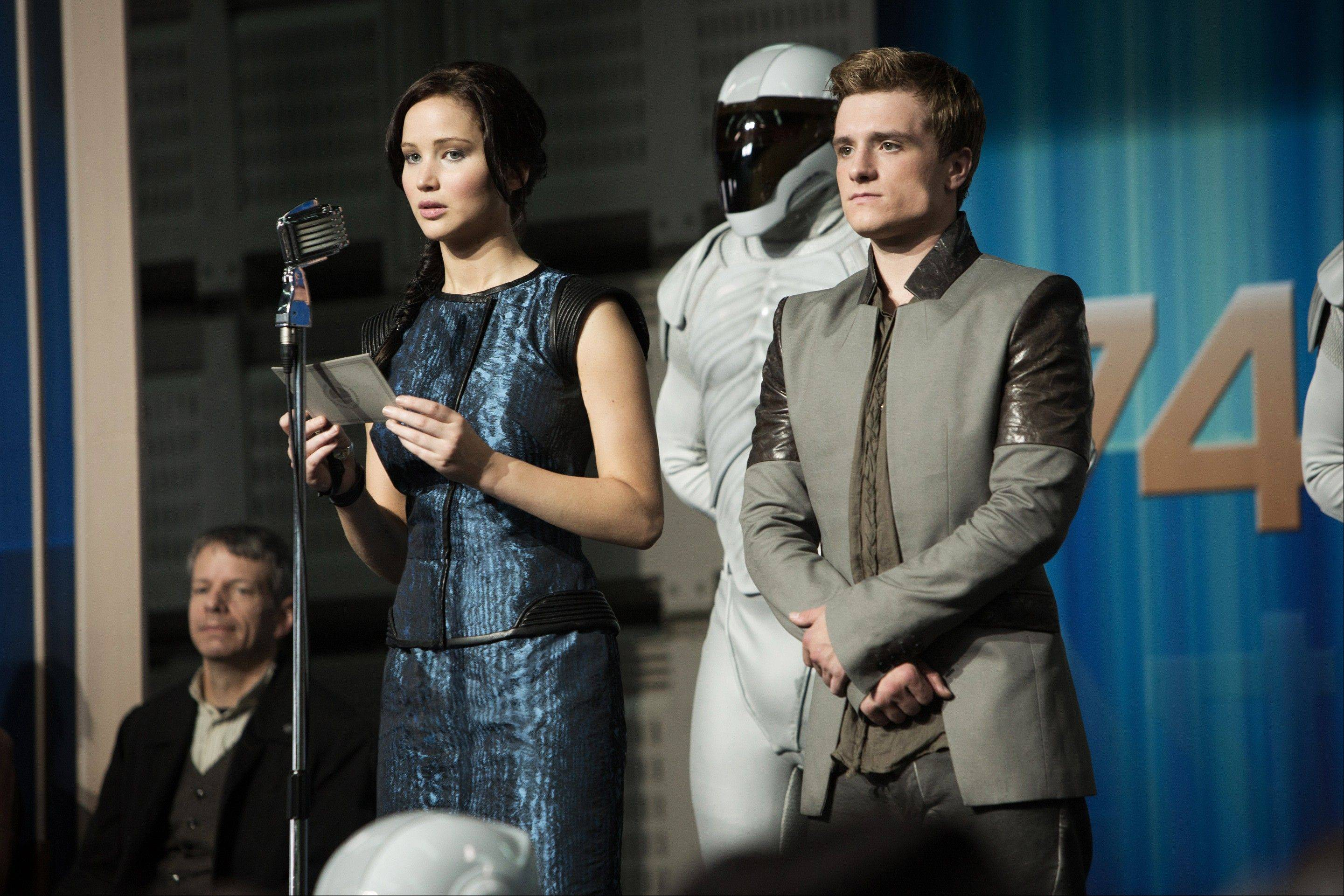 "This publicity photo released by Lionsgate shows Jennifer Lawrence, left, as Katniss Everdeen and Josh Hutcherson as Peeta Mellark in a scene from the film, ""The Hunger Games: Catching Fire."" The movie opened with $161.1 million at the box office."