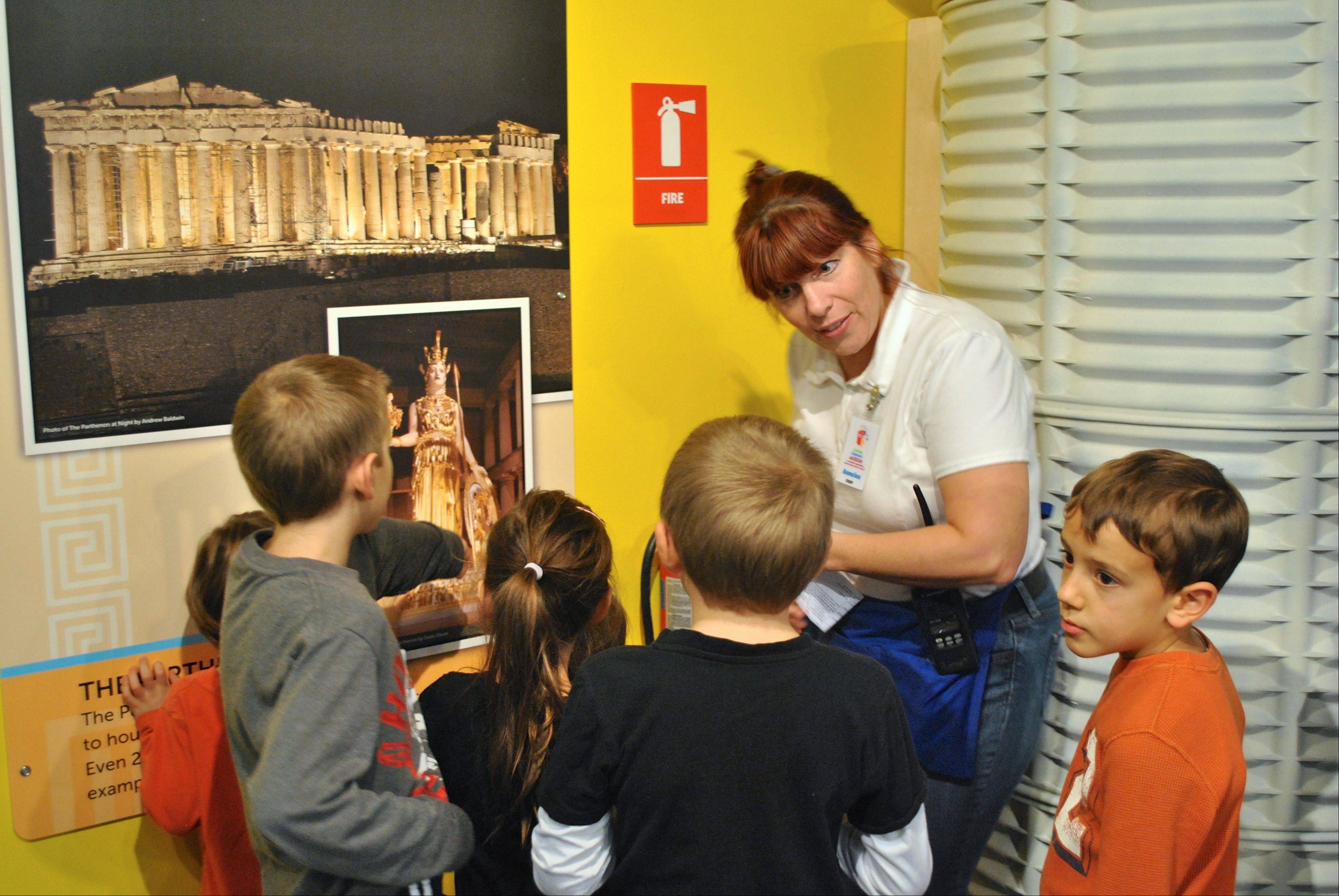 "The exhibit ""Monumental"" teaches children about ancient Greek and Mayan society."