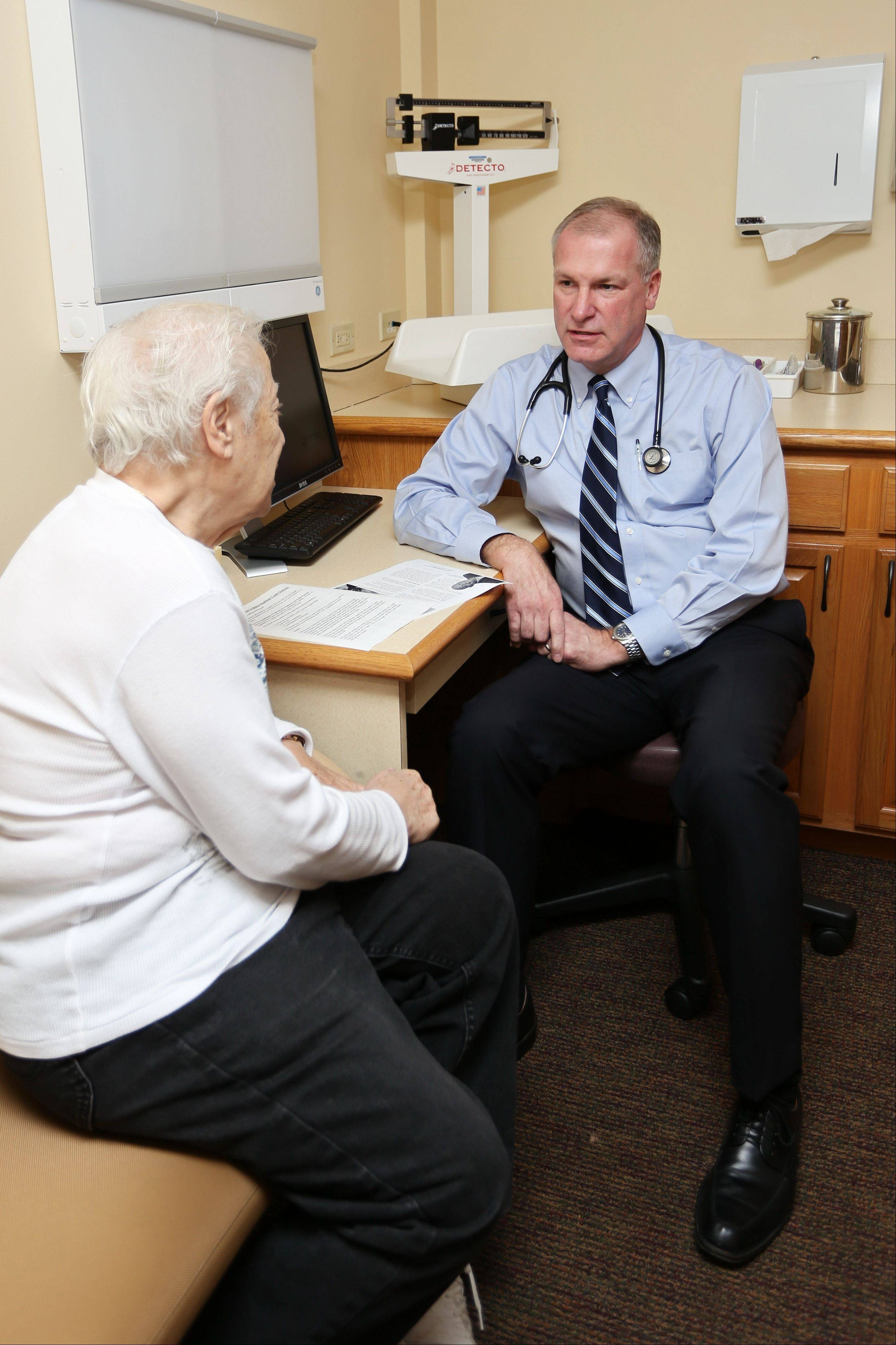 "Dr. John Wilkerson, a family practice physician with Alexian Brothers Medical Group, talks with one of his patients. Doctors around the suburbs are adopting a medical ""home"" model to better coordinate care seniors receive from multiple physicians."