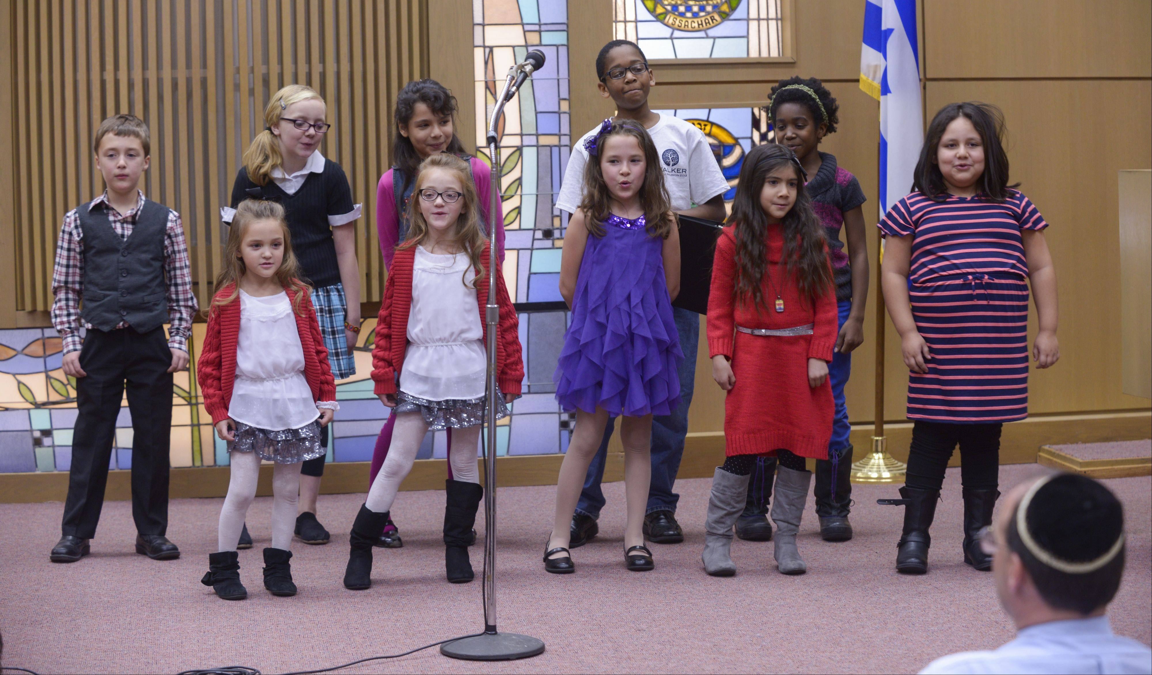 The Interfaith Children's Choir sings during Interfaith Thanksgiving service at Temple B'nai in Aurora. The annual event brings together Aurora area residents from many faiths to give thanks.