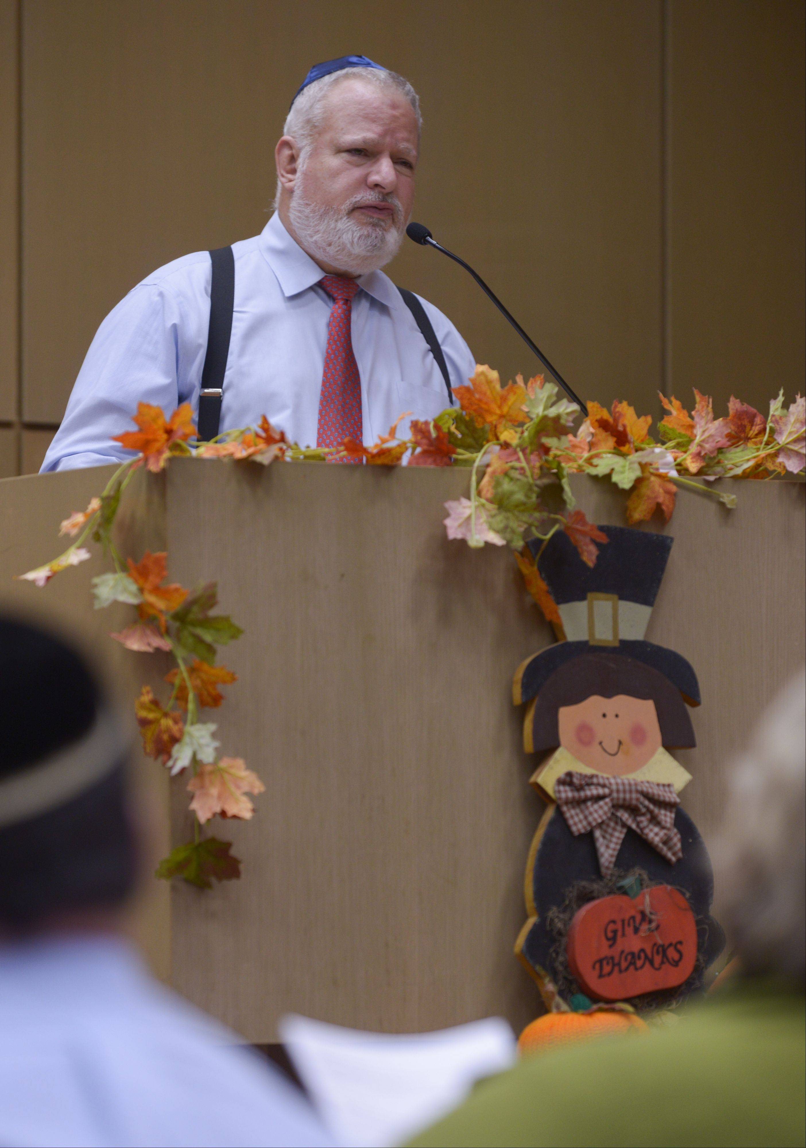 Gary Raymond of Temple B'nai Israel speaks during the Interfaith Thanksgiving service at Temple B'nai in Aurora. The annual event brings together worshippers from many faiths to give thanks.