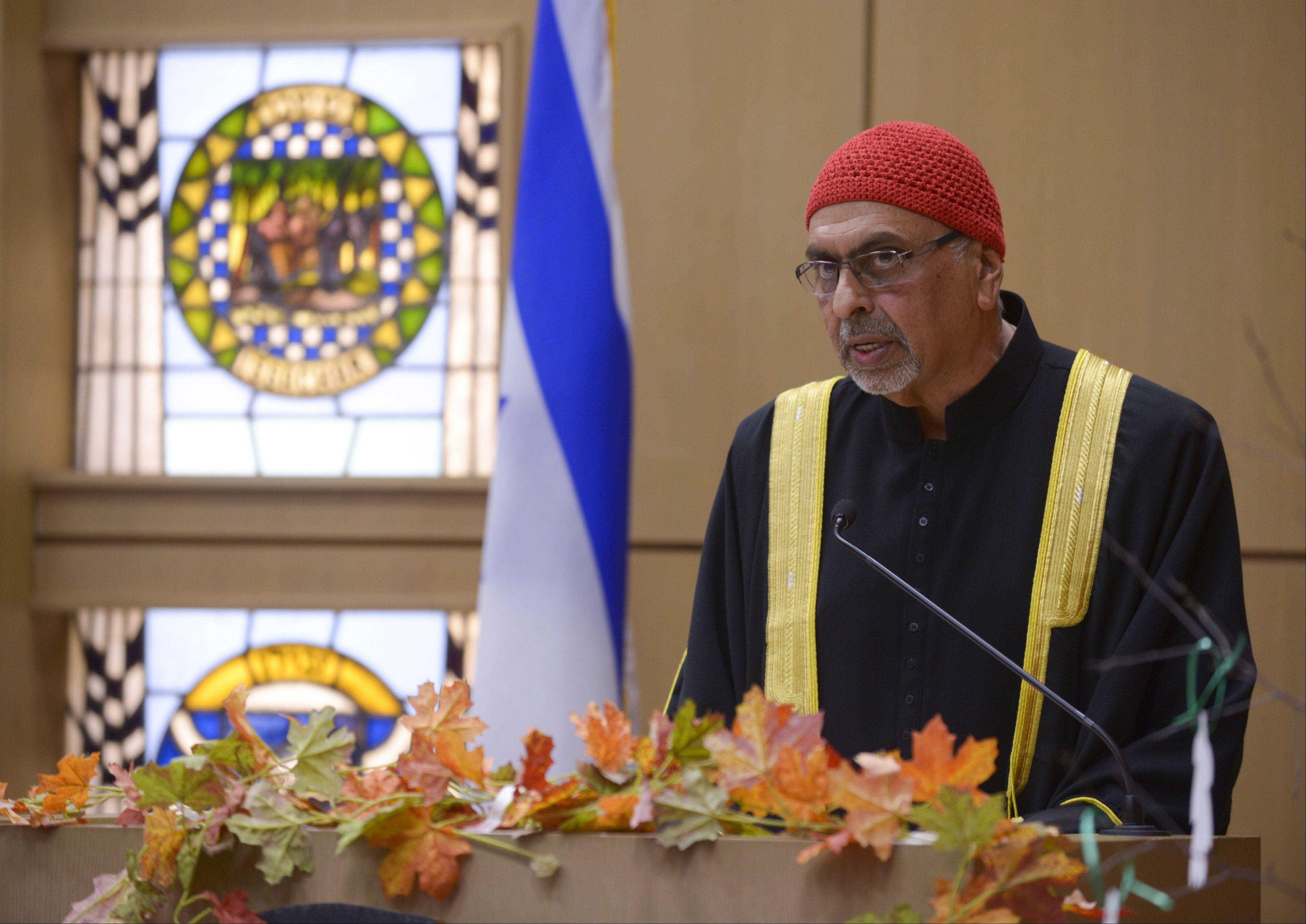 Dr. Abbas Khawaja, representing the Muslin community, speaks during the Interfaith Thanksgiving service at Temple B'nai in Aurora. The annual event brings together worshippers from many faiths to give thanks.