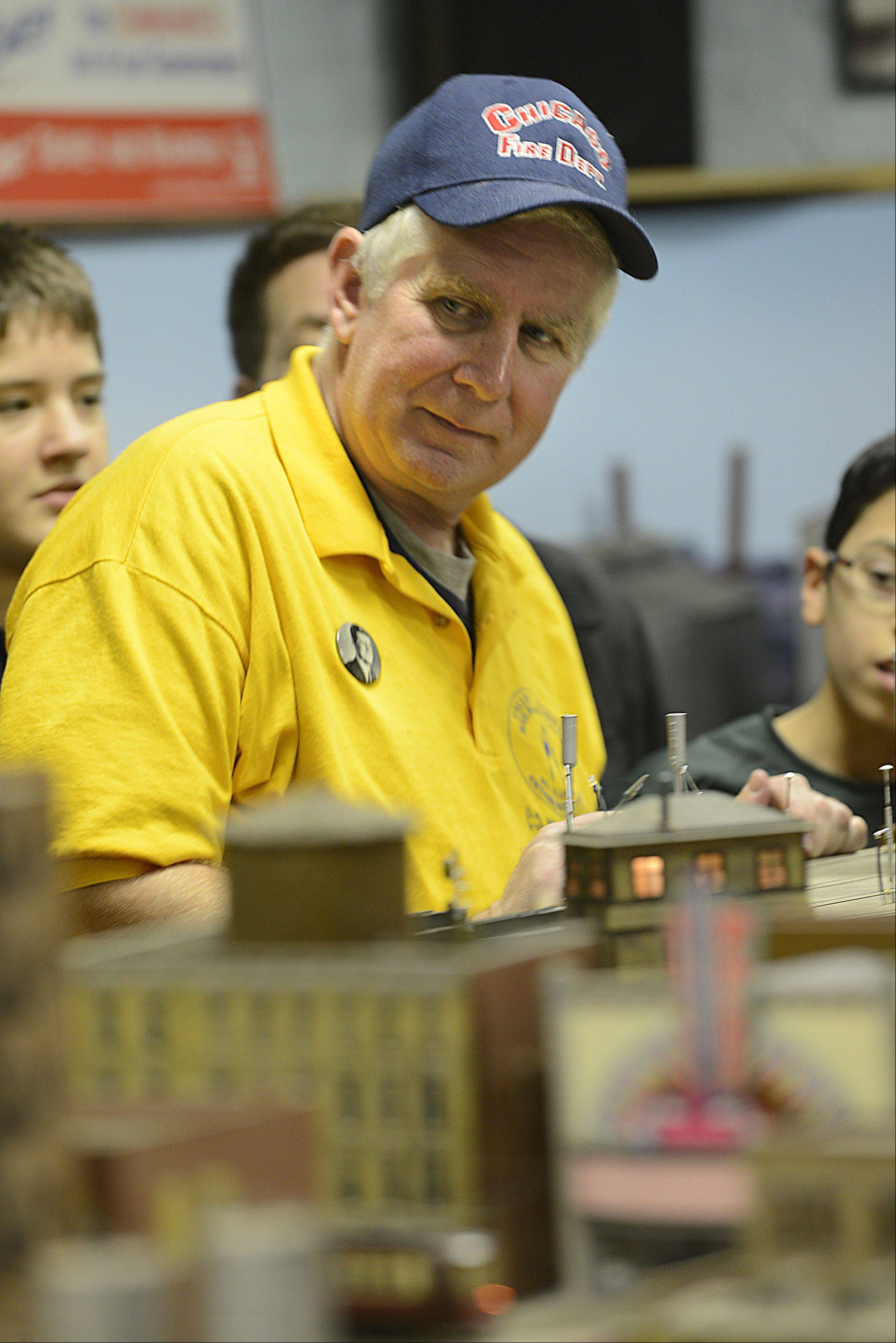 Jeff Obarek, president of the Valley Model Railroad Club, enjoys the activities Sunday during the club's annual open house at the Clintonville Station in South Elgin.