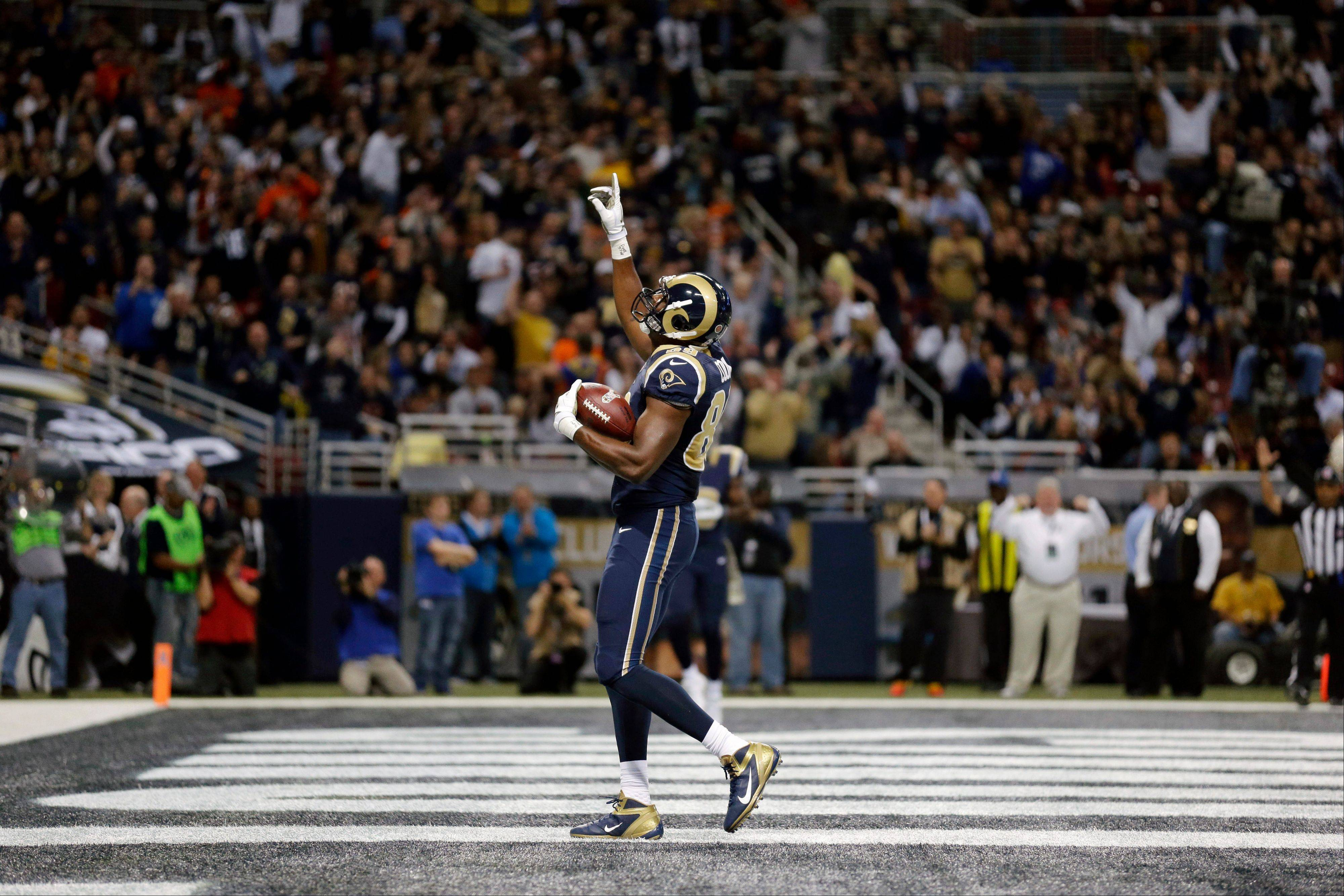 St. Louis Rams tight end Jared Cook celebrates after catching a 6-yard touchdown pass during the first quarter.