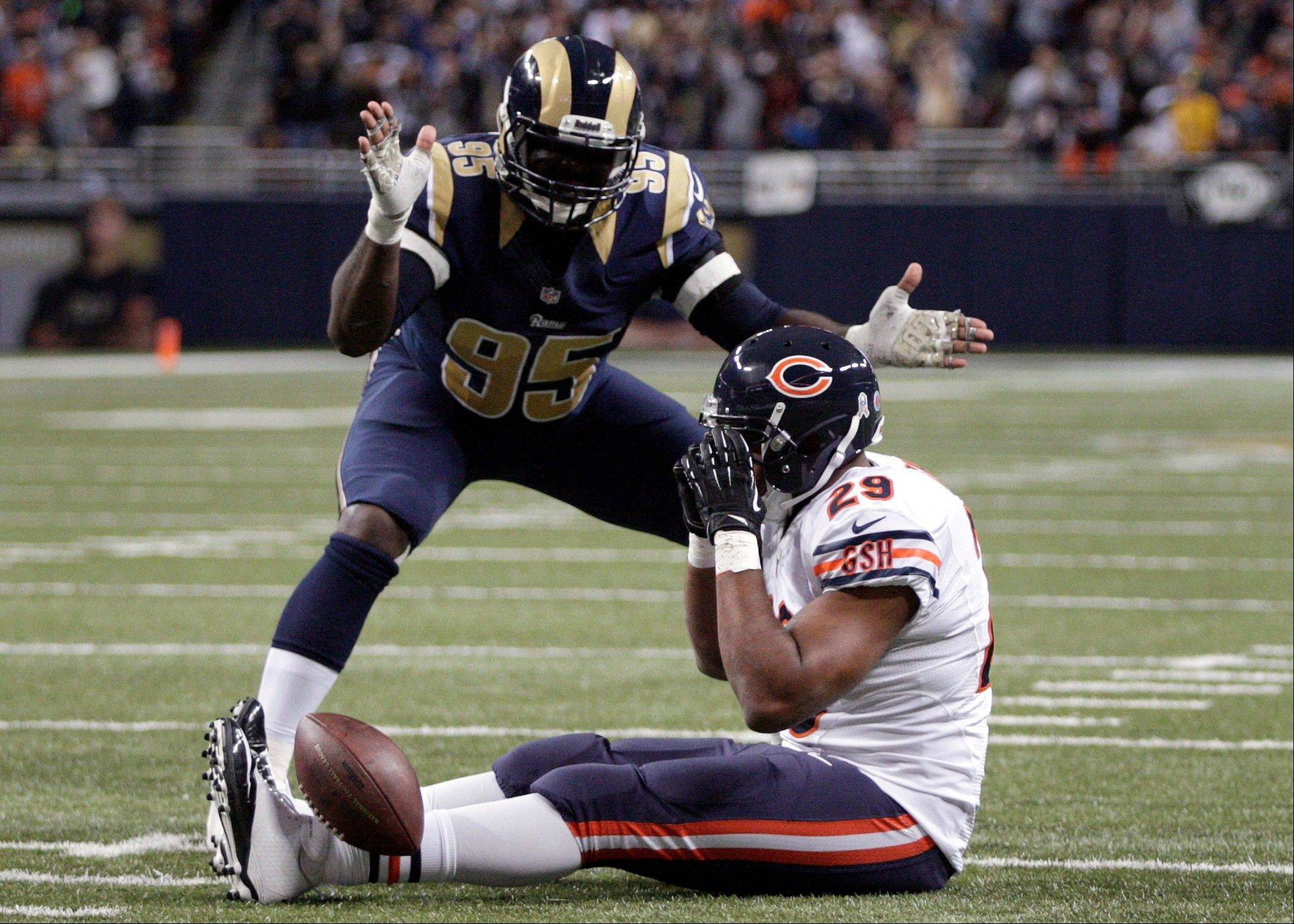 St. Louis Rams defensive end William Hayes, top, applauds after Chicago Bears running back Michael Bush (29) was stopped short of the end zone for a 4-yard loss on fourth down during the third quarter.