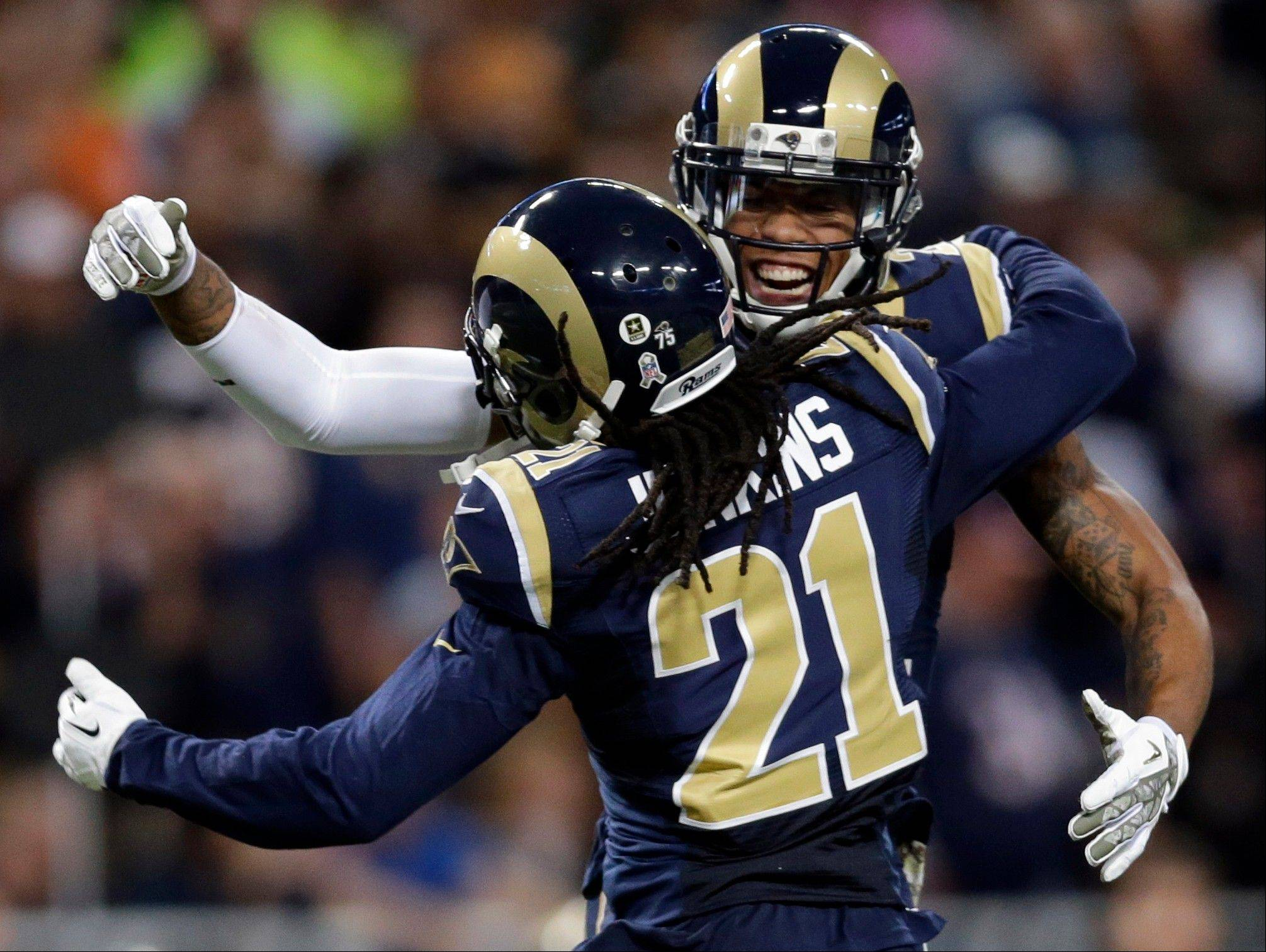 St. Louis Rams cornerback Janoris Jenkins (21) is congratulated by teammate Trumaine Johnson after intercepting a pass during the second quarter.