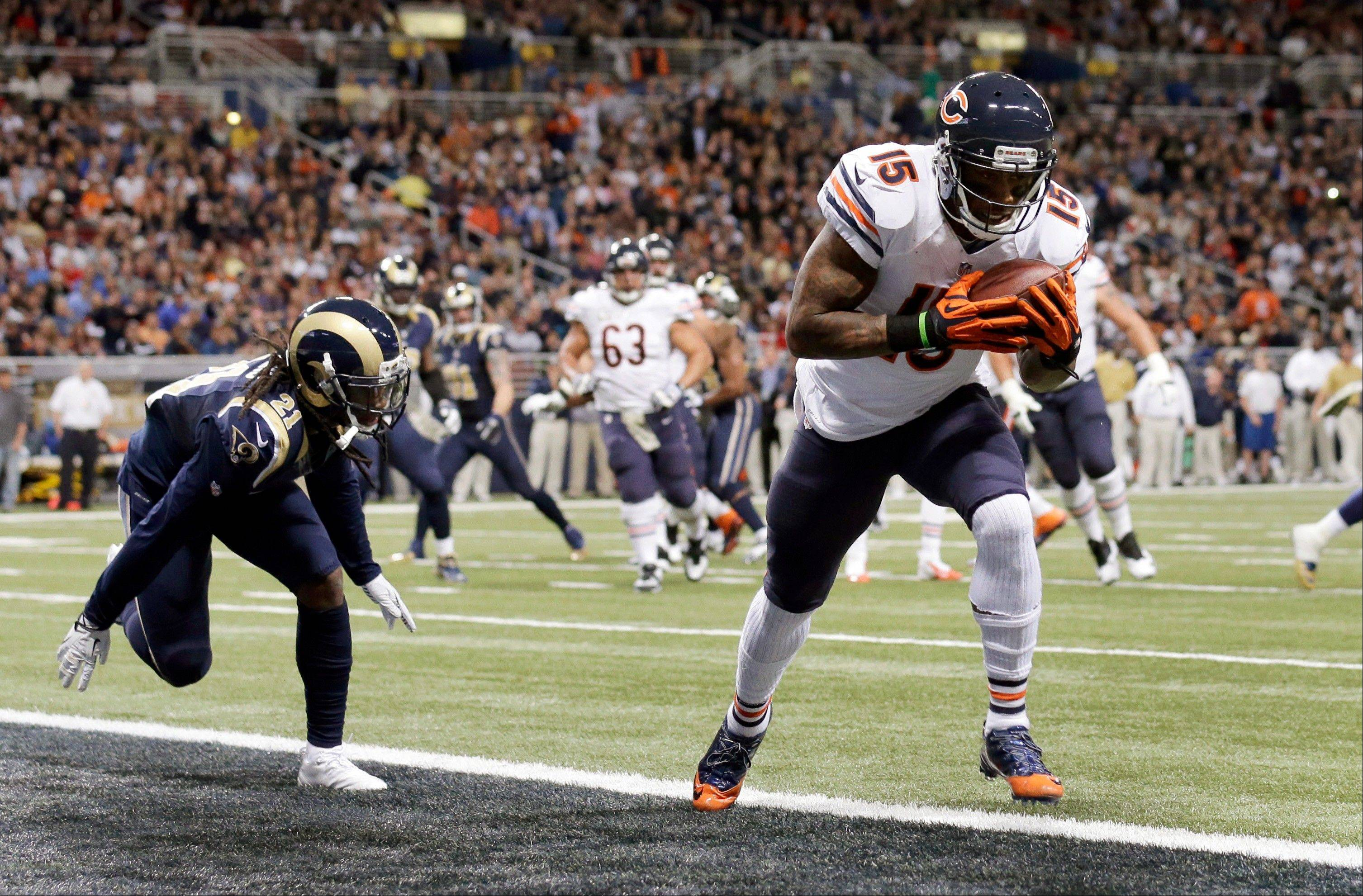 Chicago Bears wide receiver Brandon Marshall, right, catches a 3-yard touchdown pass as St. Louis Rams cornerback Janoris Jenkins defends during the second quarter.