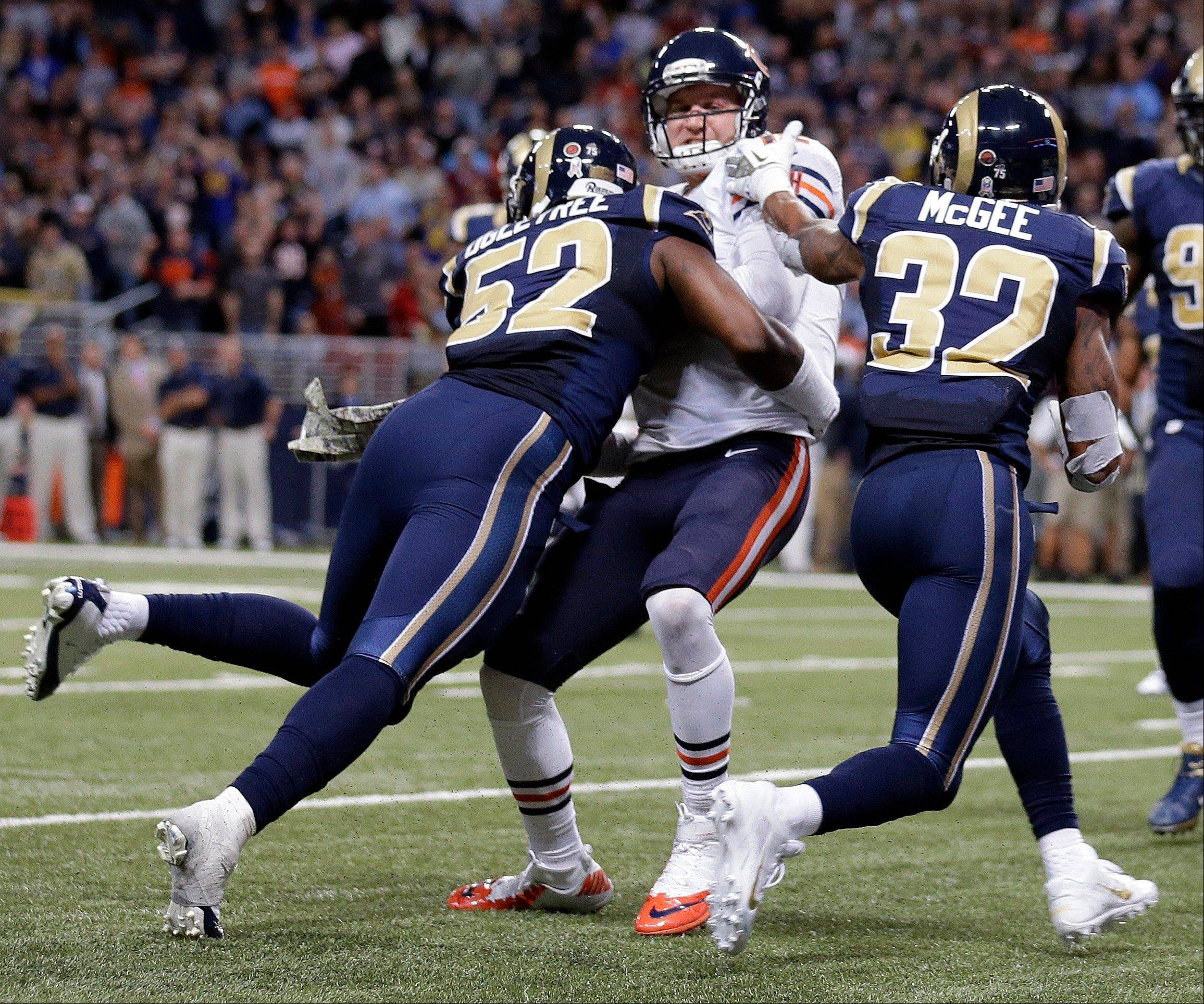 Chicago Bears quarterback Josh McCown, center, runs with the ball but is stopped short of the end zone by St. Louis Rams linebacker Alec Ogletree (52) and cornerback Brandon McGee (32) during the third quarter.