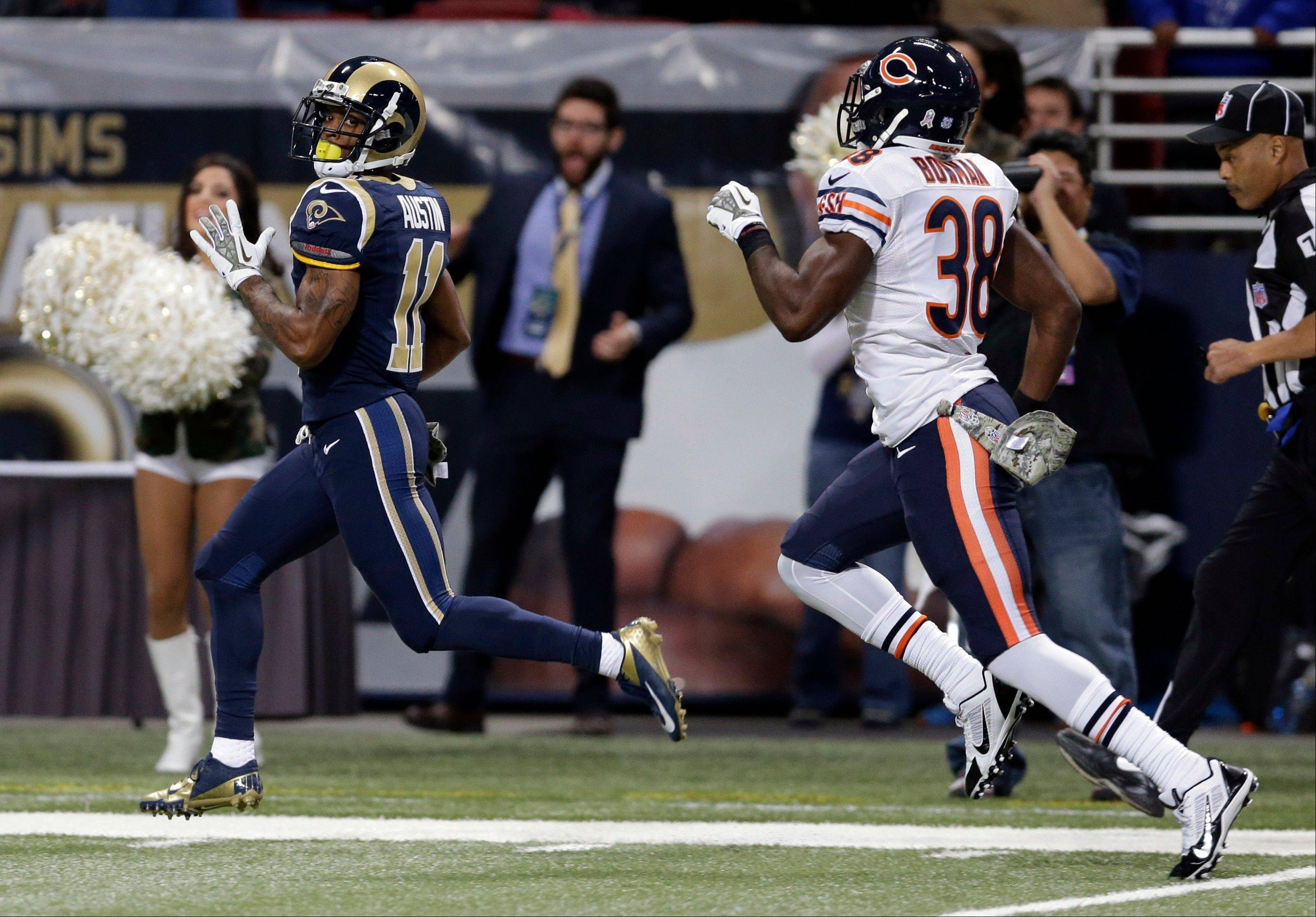 St. Louis Rams wide receiver Tavon Austin, left, runs past Chicago Bears cornerback Zack Bowman on his way to a 65-yard touchdown run during the first quarter of an NFL football game on Sunday, Nov. 24, 2013, in St. Louis.