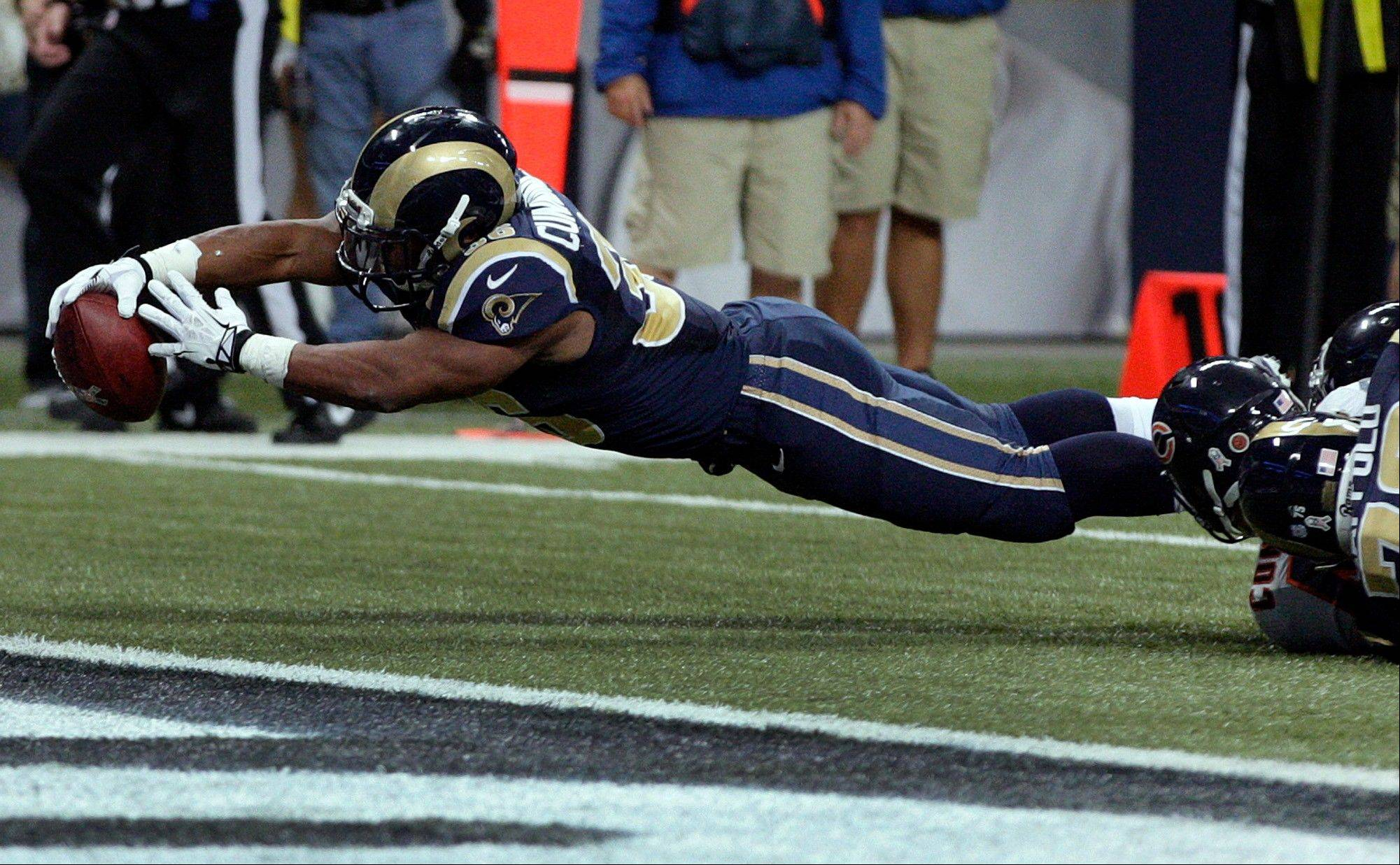 St. Louis Rams running back Benny Cunningham dives into the end zone for a 9-yard touchdown during the fourth quarter. The Rams won 42-21.