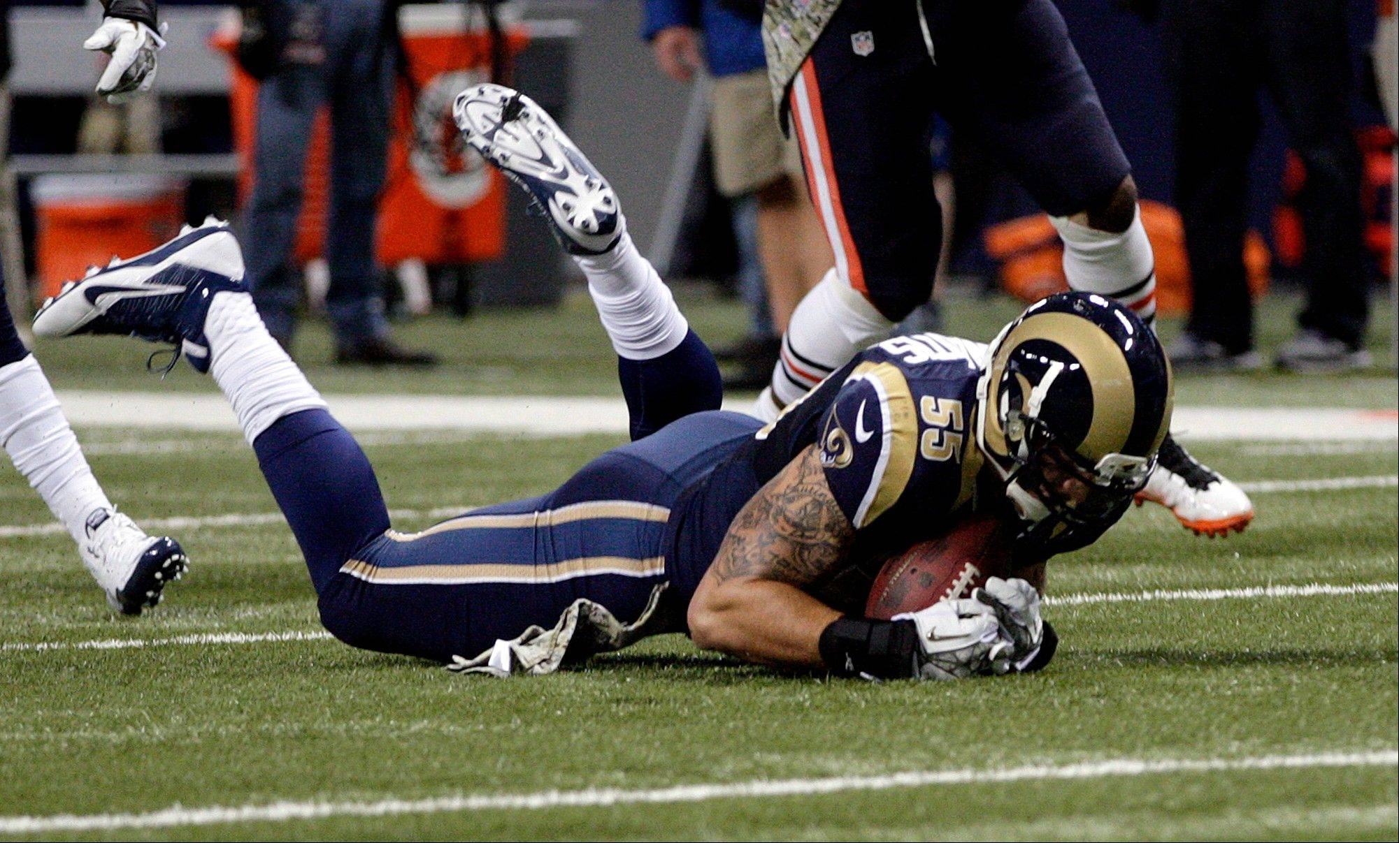 St. Louis Rams linebacker James Laurinaitis recovers a fumble by Chicago Bears running back Matt Forte during the first quarter.