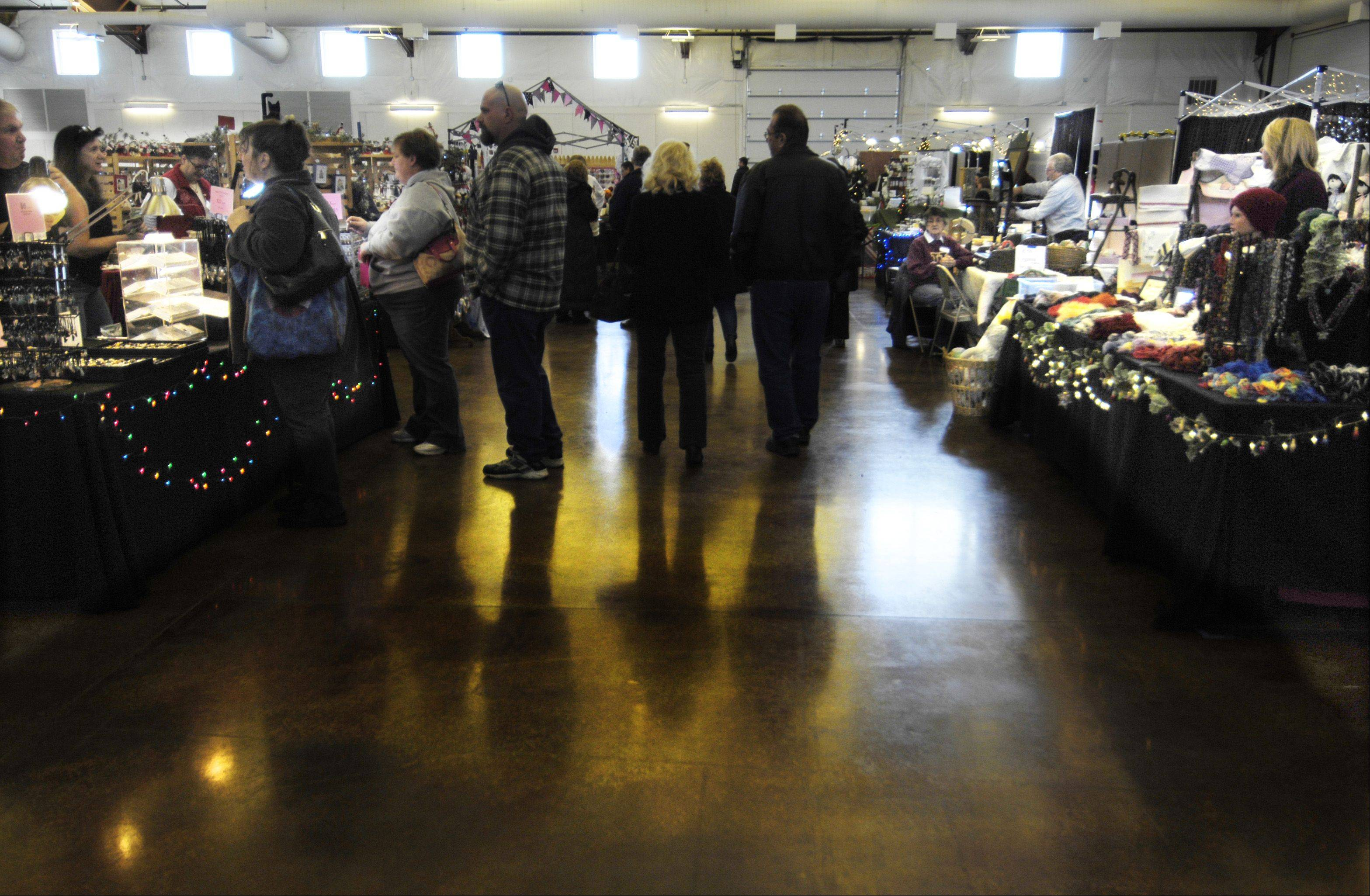 Browsers and buyers wandered through two rooms of booths Sunday at the Christmas on the Fox Arts and Crafts Show at the Kane County Fairgrounds in St. Charles.