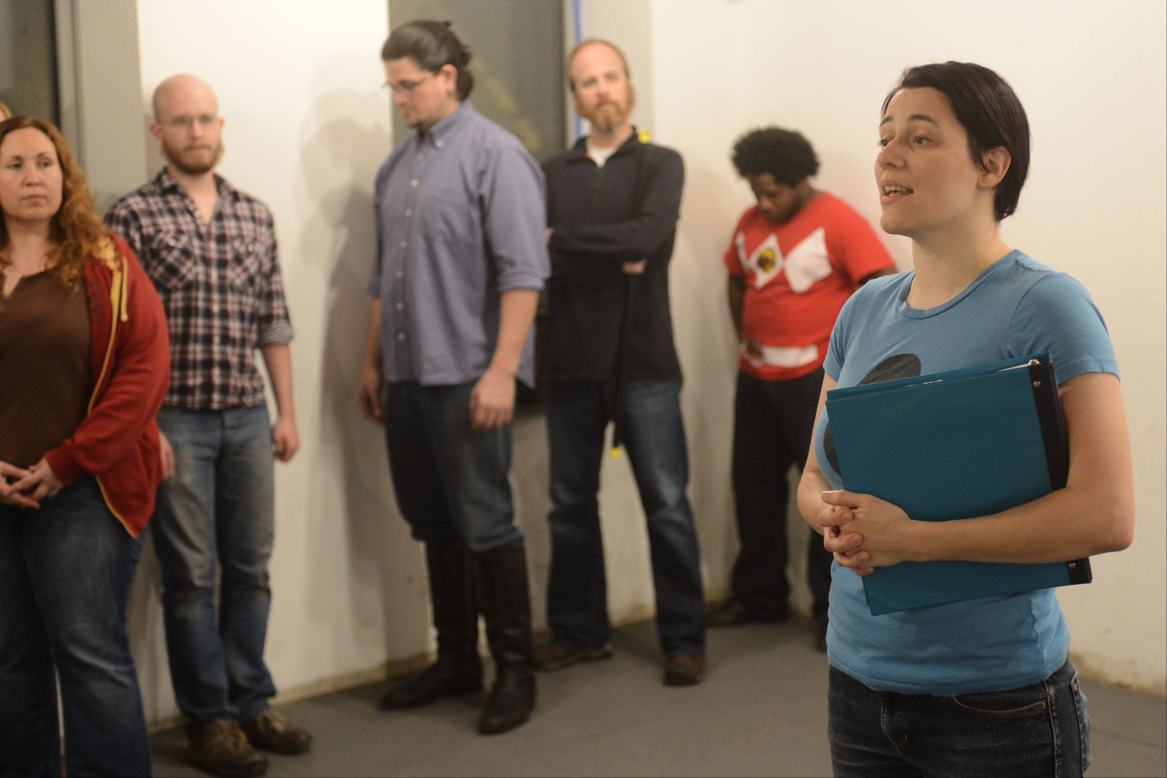 "Running through the opening scene in this rehearsal with fellow cast members, Oak Brook native Beth Richards will be wearing pointy Vulcan ears in her role as the narrator for ""A Klingon Christmas Carol."" The other 14 cast members all sport the ridged foreheads of Klingons, the fictional warrior race from ""Star Trek."""