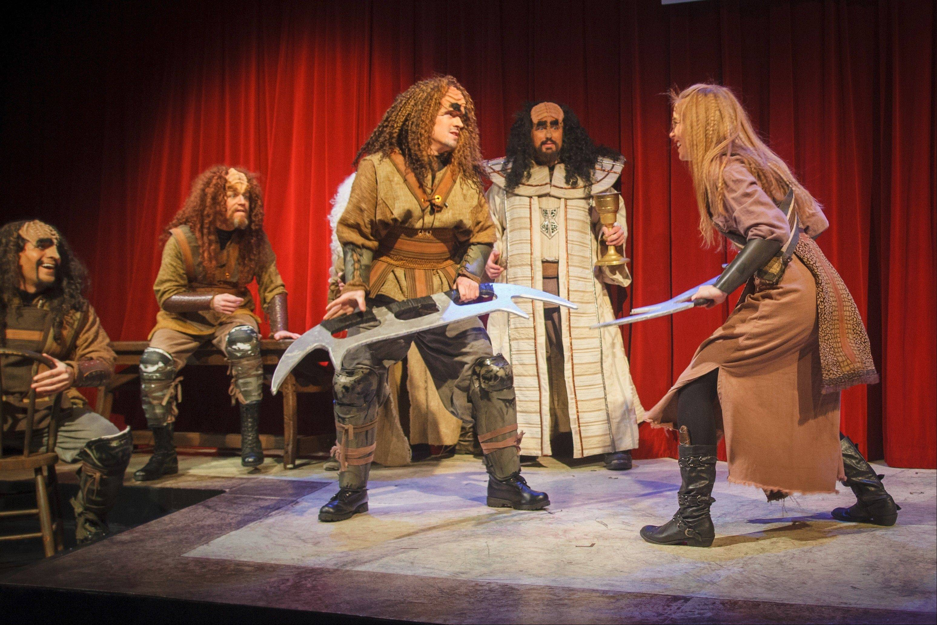 "Unlike the classic tale written by Charles Dickens, ""A Klingon Christmas Carol"" features plenty of battles, such as this one brewing between vreD (played by David Coupe) and marja' (played by Ali Kidder-Mostrom)."