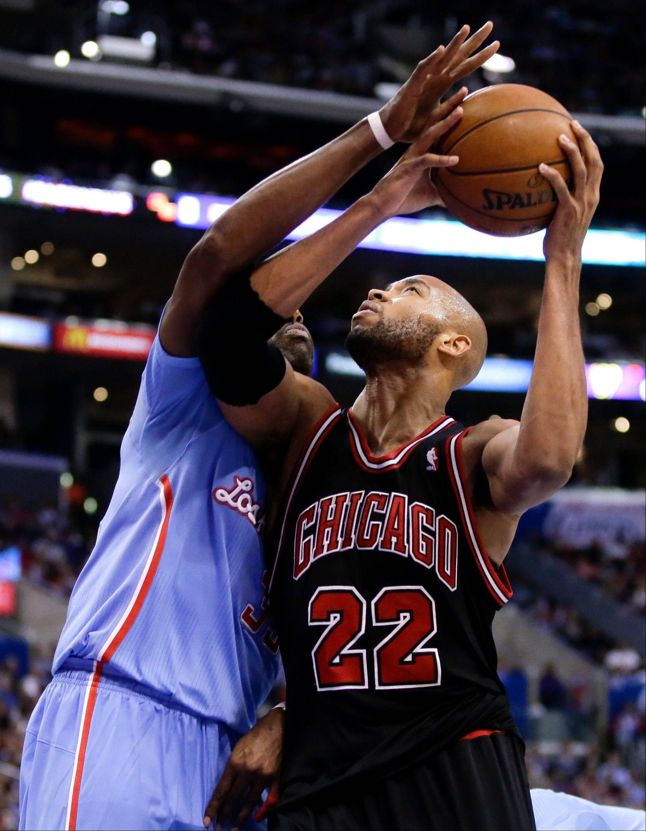 Los Angeles Clippers forward Antawn Jamison, left, blocks a shot by Chicago Bulls forward Taj Gibson (22) during the second half of an NBA basketball game in Los Angeles, Sunday, Nov. 24, 2013. The Clippers won 121-82.
