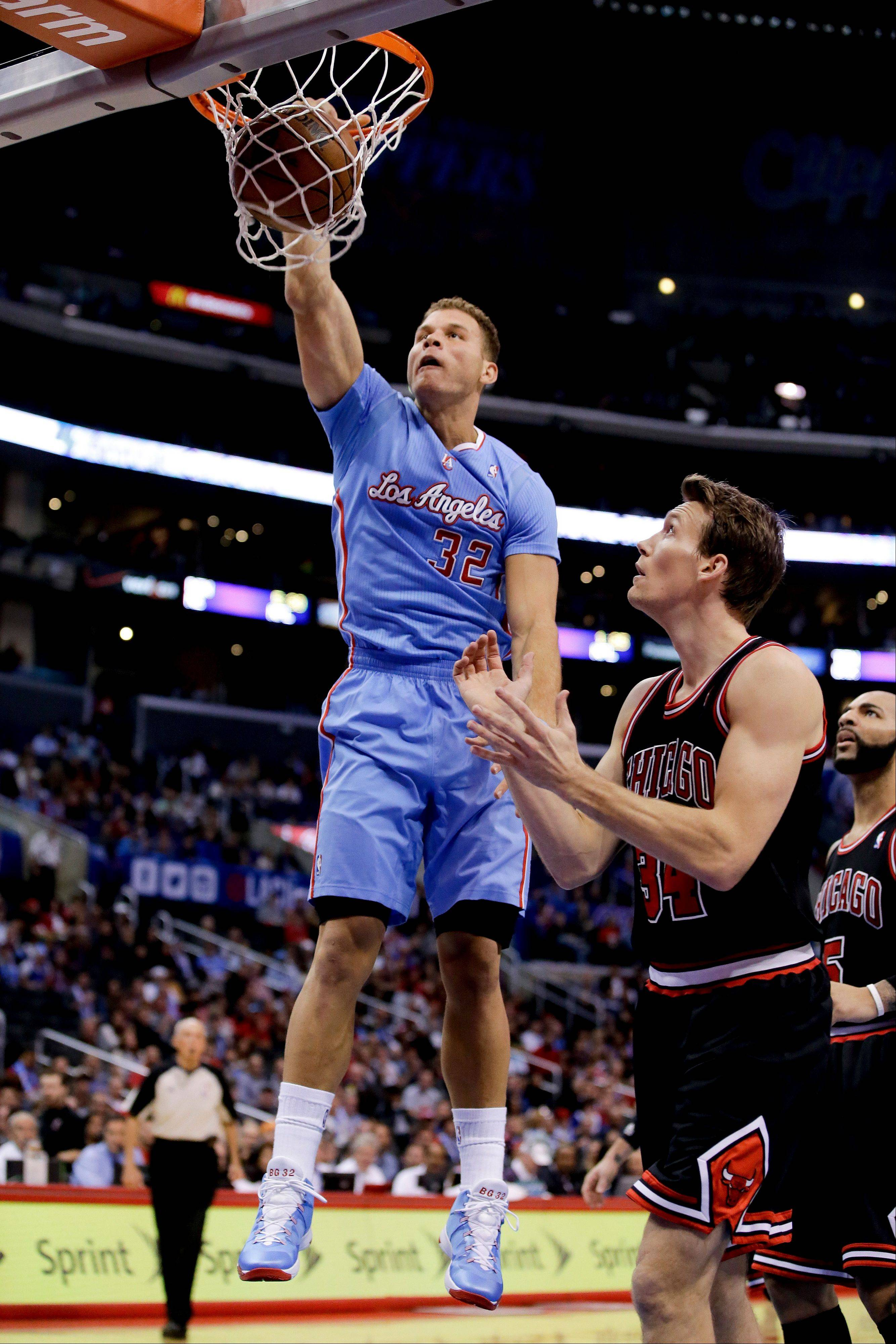 Los Angeles Clippers forward Blake Griffin, left, dunks as Chicago Bulls forward Mike Dunleavy looks on during the first half of an NBA basketball game in Los Angeles, Sunday, Nov. 24, 2013.