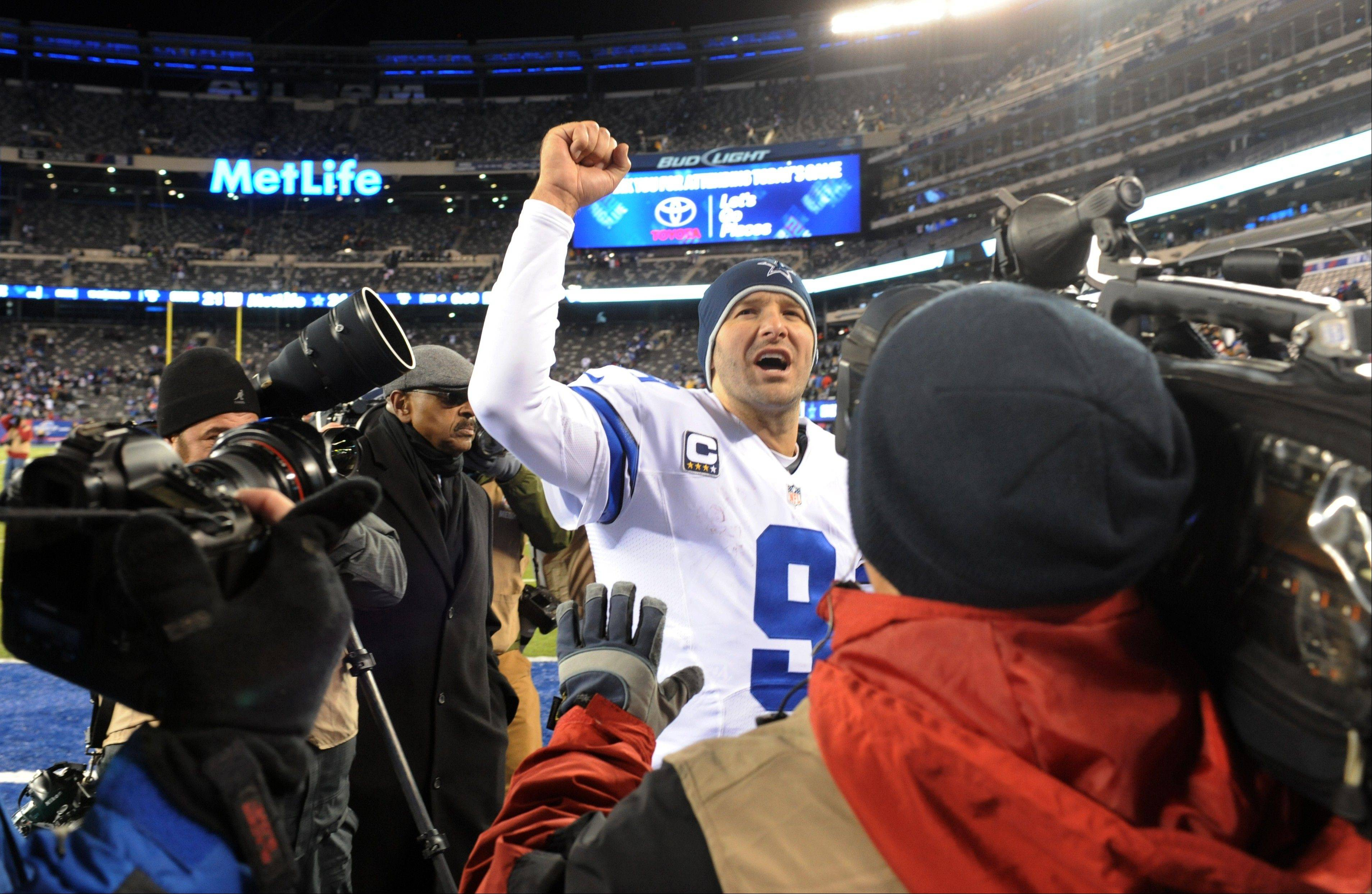 Dallas Cowboys quarterback Tony Romo (9) gestures while leaving the field after an NFL football game against the New York Giants, Sunday, Nov. 24, 2013, in East Rutherford, N.J. The Cowboys won 24-21.