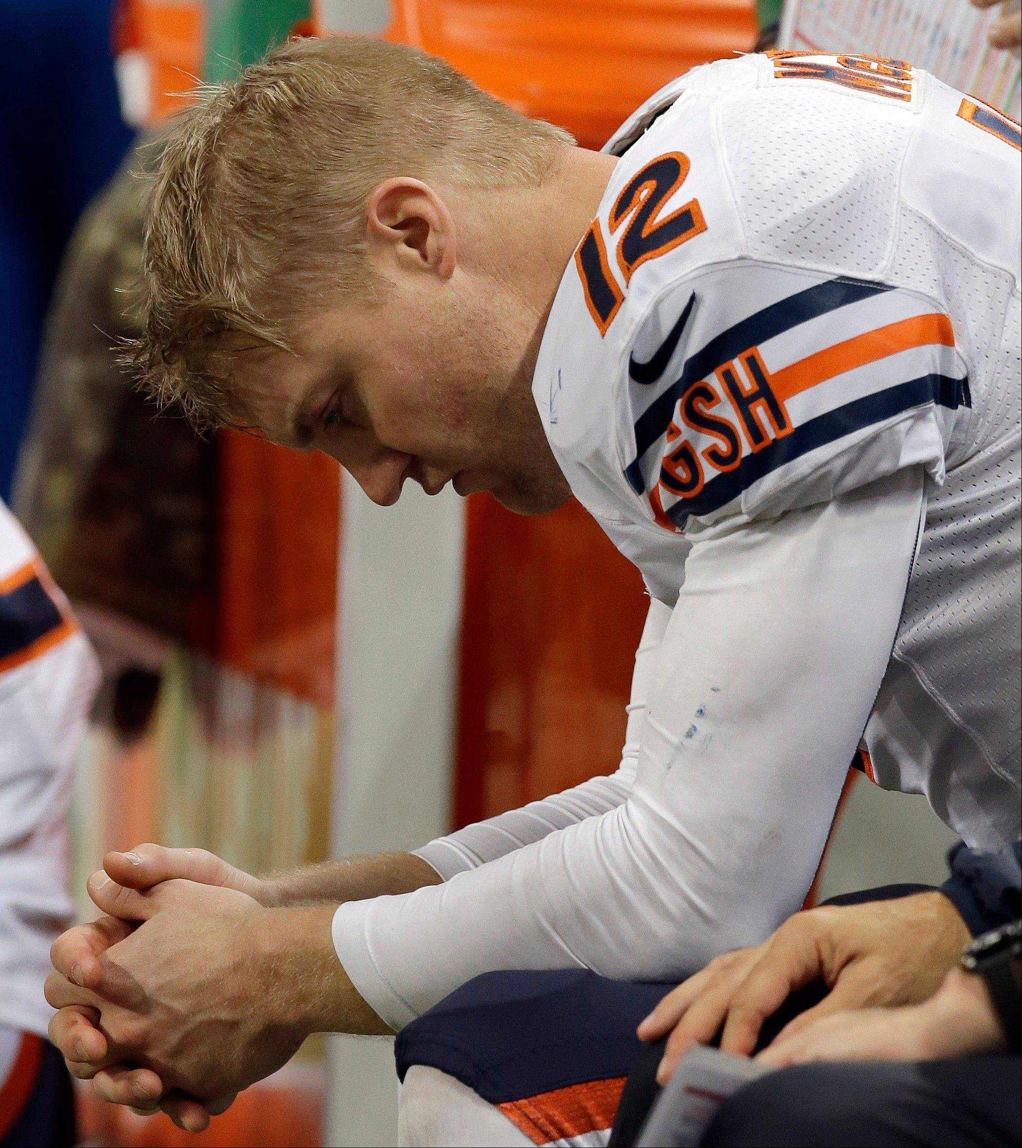 Bears quarterback Josh McCown sits on the bench during the last minute of an NFL football game against the St. Louis Rams, Sunday, Nov. 24, 2013, in St. Louis. The Rams won 42-21.