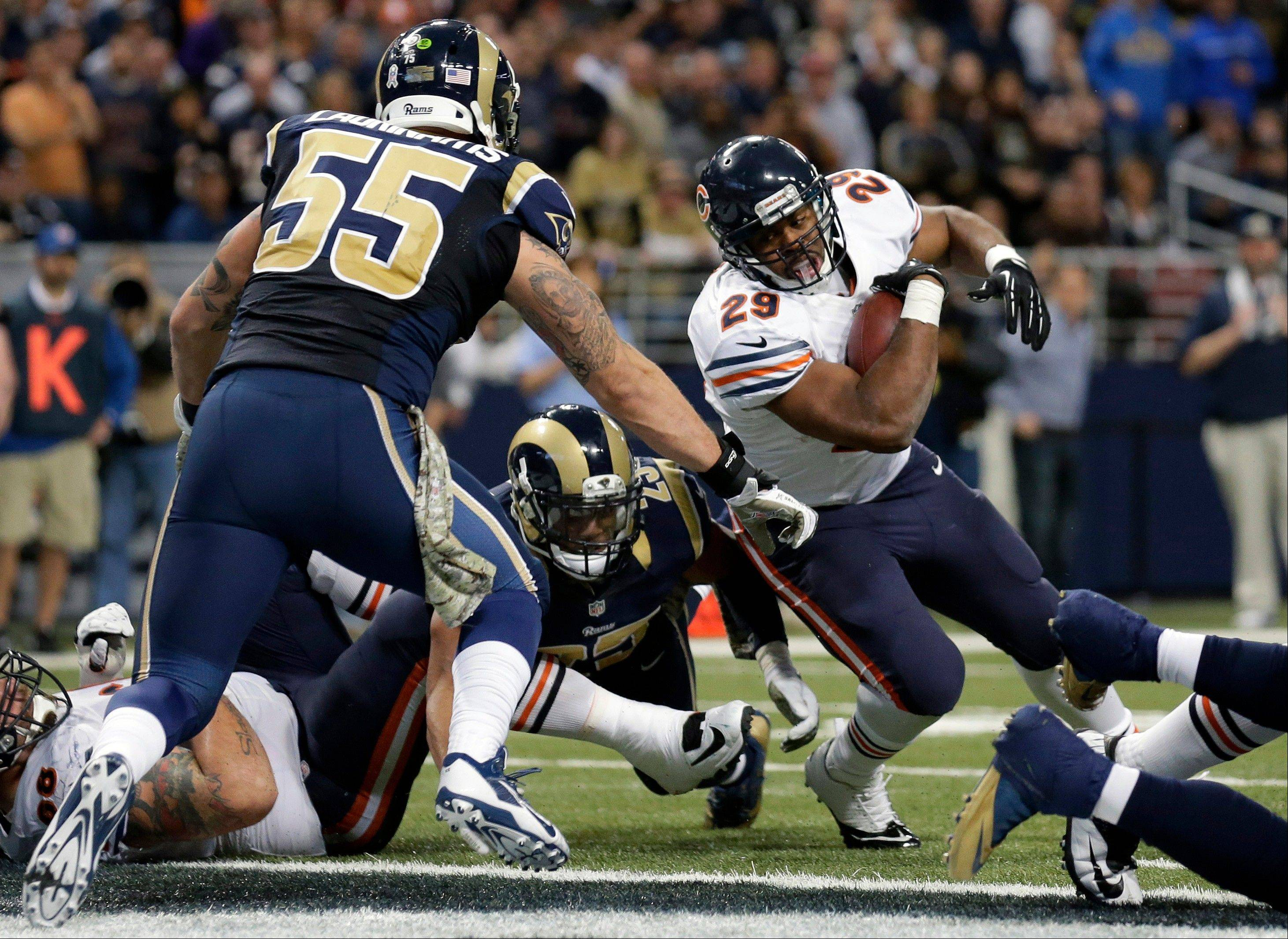 Bears running back Michael Bush, right, scores on a 1-yard run past St. Louis Rams linebacker James Laurinaitis (55) and safety T.J. McDonald during the fourth quarter of an NFL football game on Sunday, Nov. 24, 2013, in St. Louis.