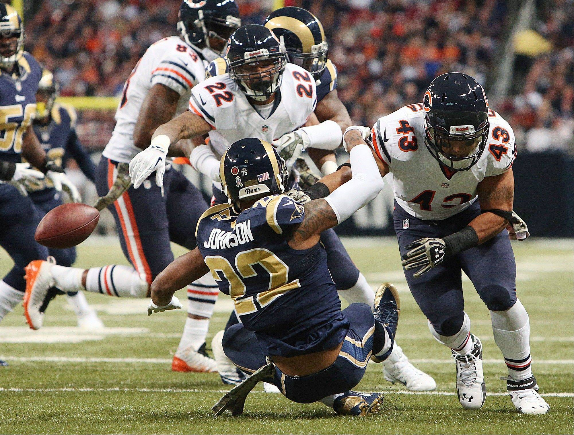 Rams cornerback Trumaine Johnson (22) forces a fumble by Chicago Bears running back Matt Forte (22) during the first half of an NFL football game on Sunday, Nov. 24, 2013, in St. Louis.