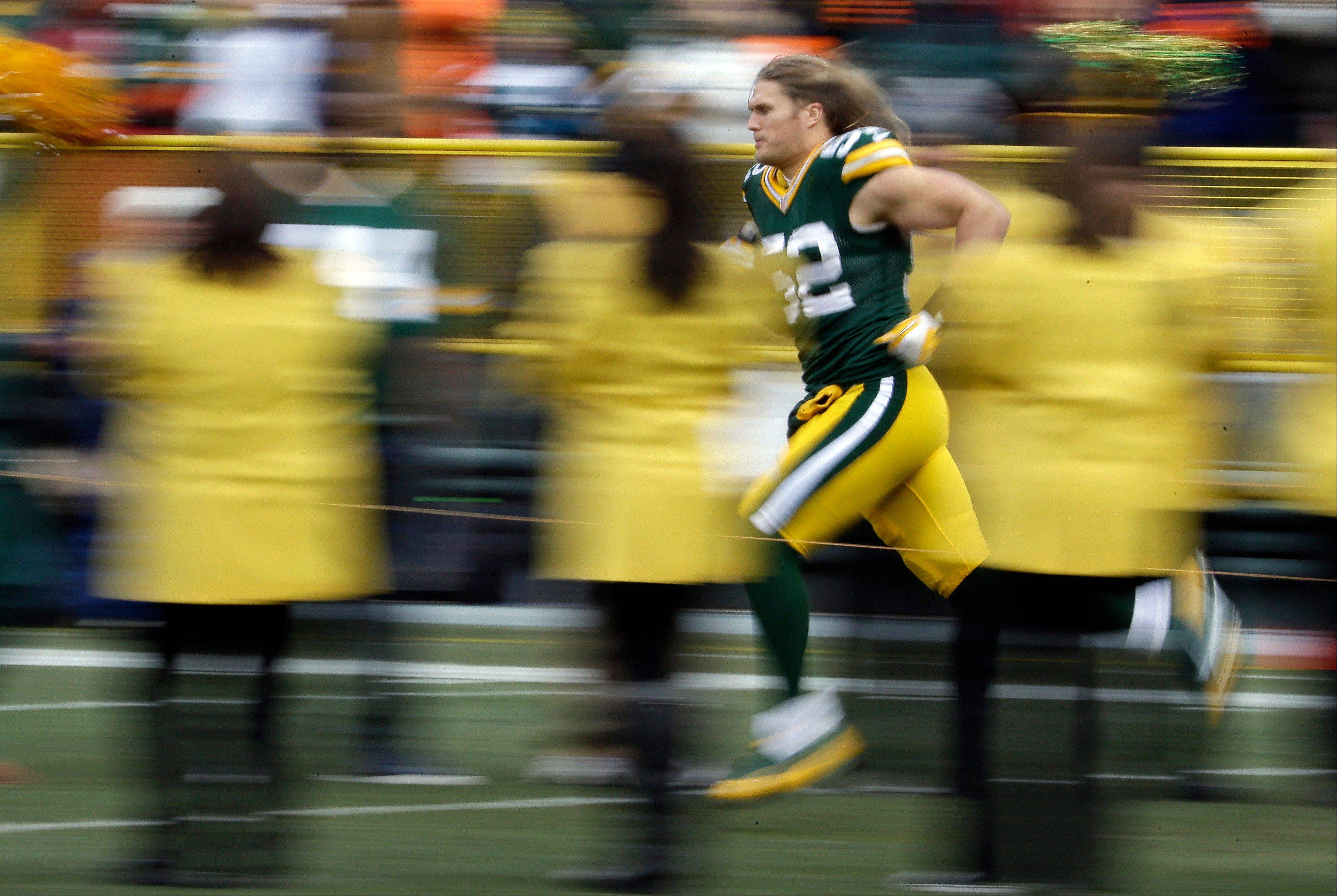 Green Bay Packers' Clay Matthews is introduced before the first half of an NFL football game against the Minnesota Vikings Sunday, Nov. 24, 2013, in Green Bay, Wis.