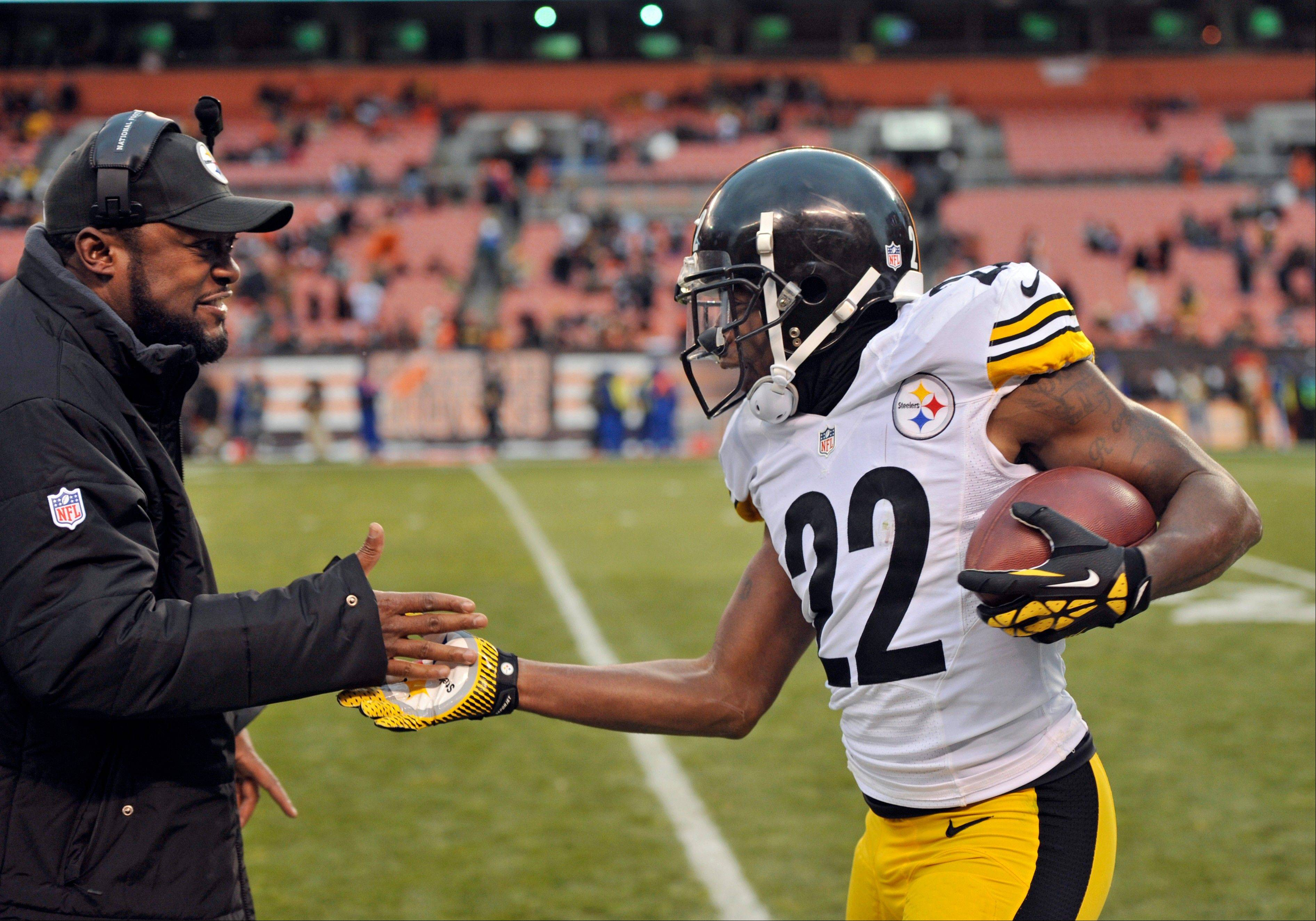 Pittsburgh Steelers cornerback William Gay (22) is congratulated by head coach Mike Tomlin after Gay returned an interception 21 yards for a touchdown against the Cleveland Browns in the fourth quarter of an NFL football game Sunday, Nov. 24, 2013.