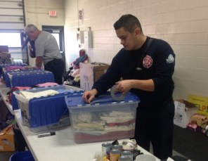 West Chicago fire fighters turned HQ into donation collection center.