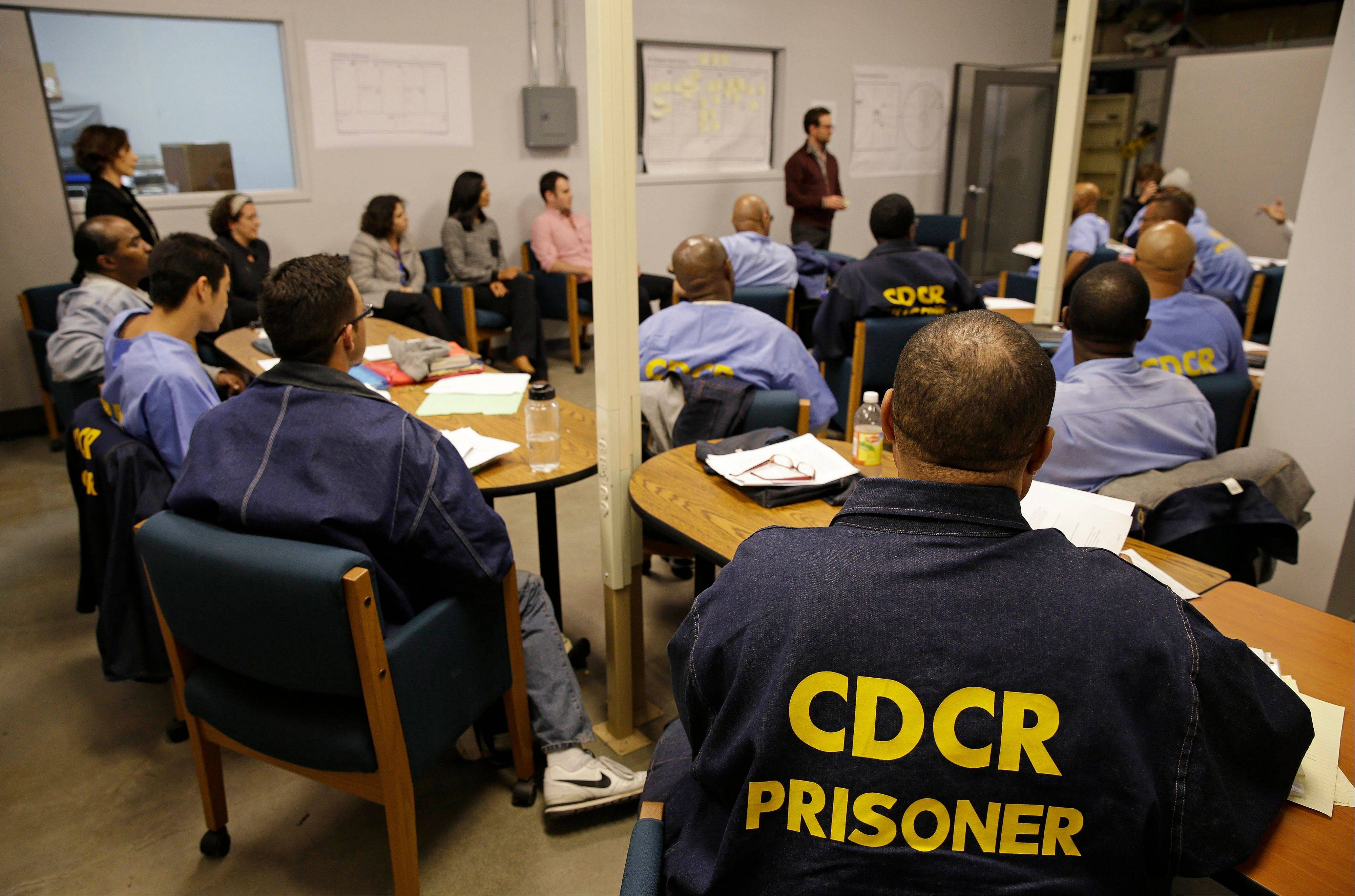 Inmates listen as Andrew Kaplan, a product marketing manager at Linkedin, leads a session of The Last Mile at San Quentin State Prison in San Quentin, Calif.