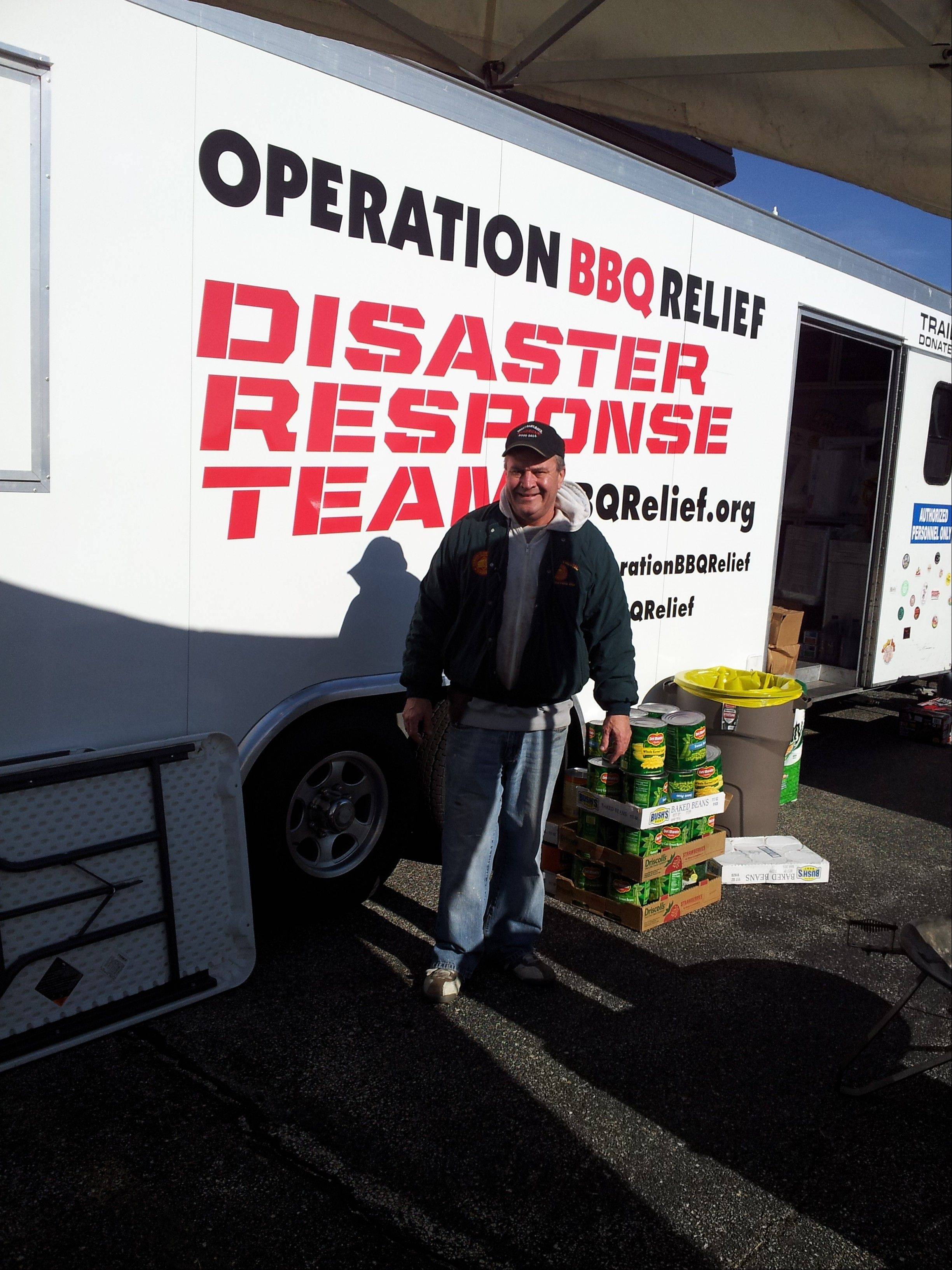 Ron Nunes of Elk Grove Village works with Operation BBQ Relief in downstate Washington after a powerful tornado ravaged the town.
