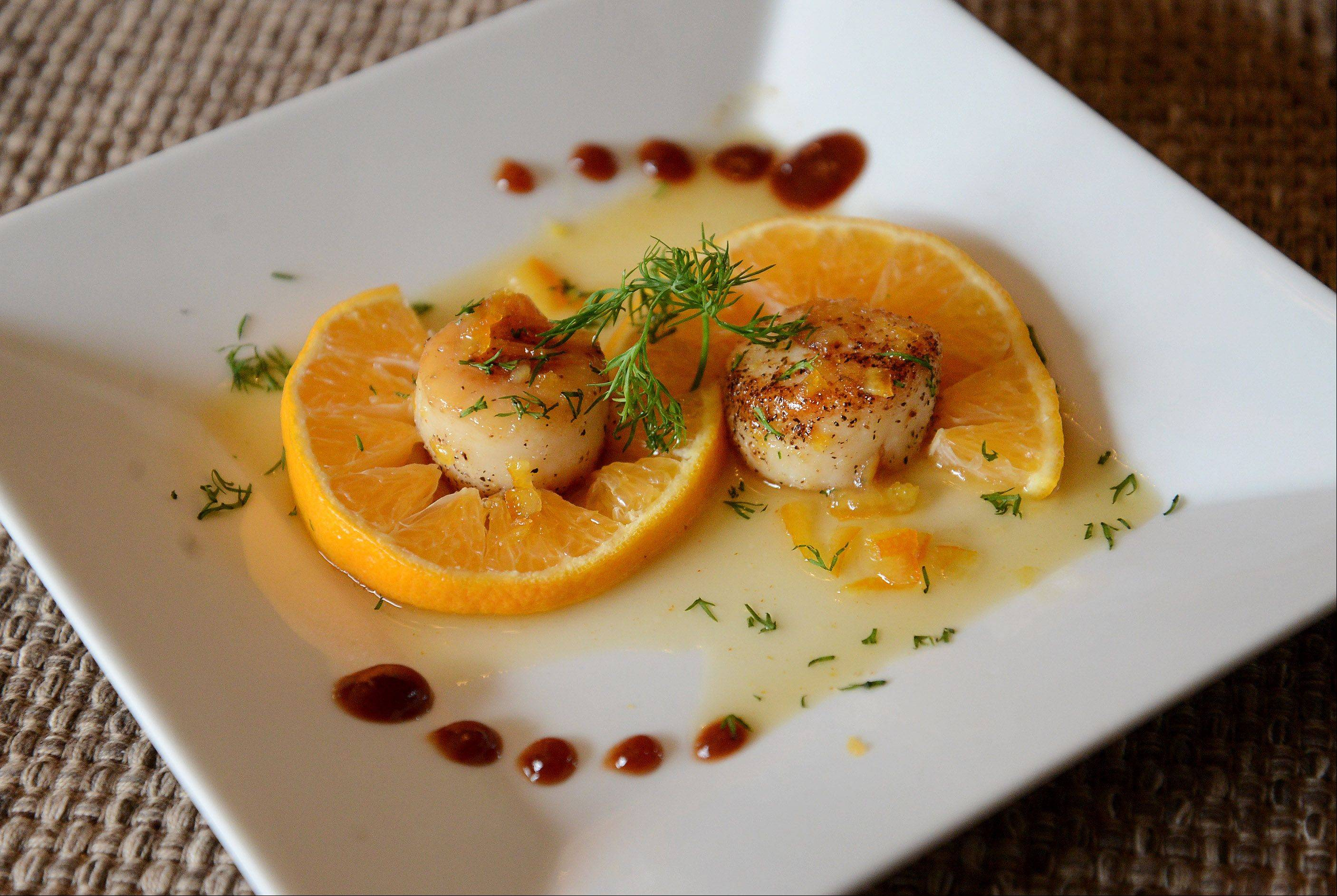 Joe Moninski serves seared scallops on a bed of clementine slices and drizzles them with Grand Marnier sauce.