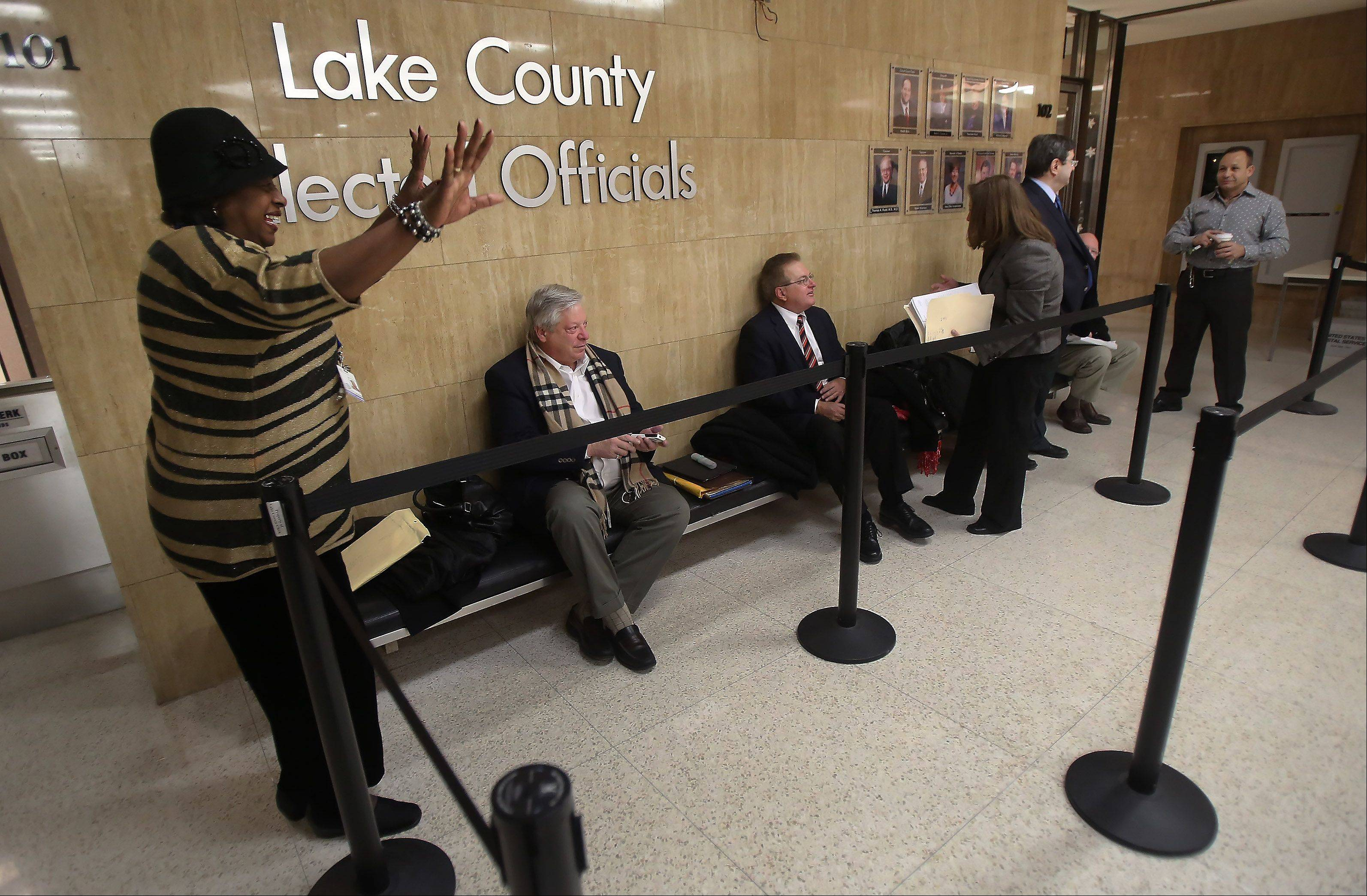 Lake County Board member Mary Ross Cunningham of Waukegan celebrates being the first candidate in line Monday.