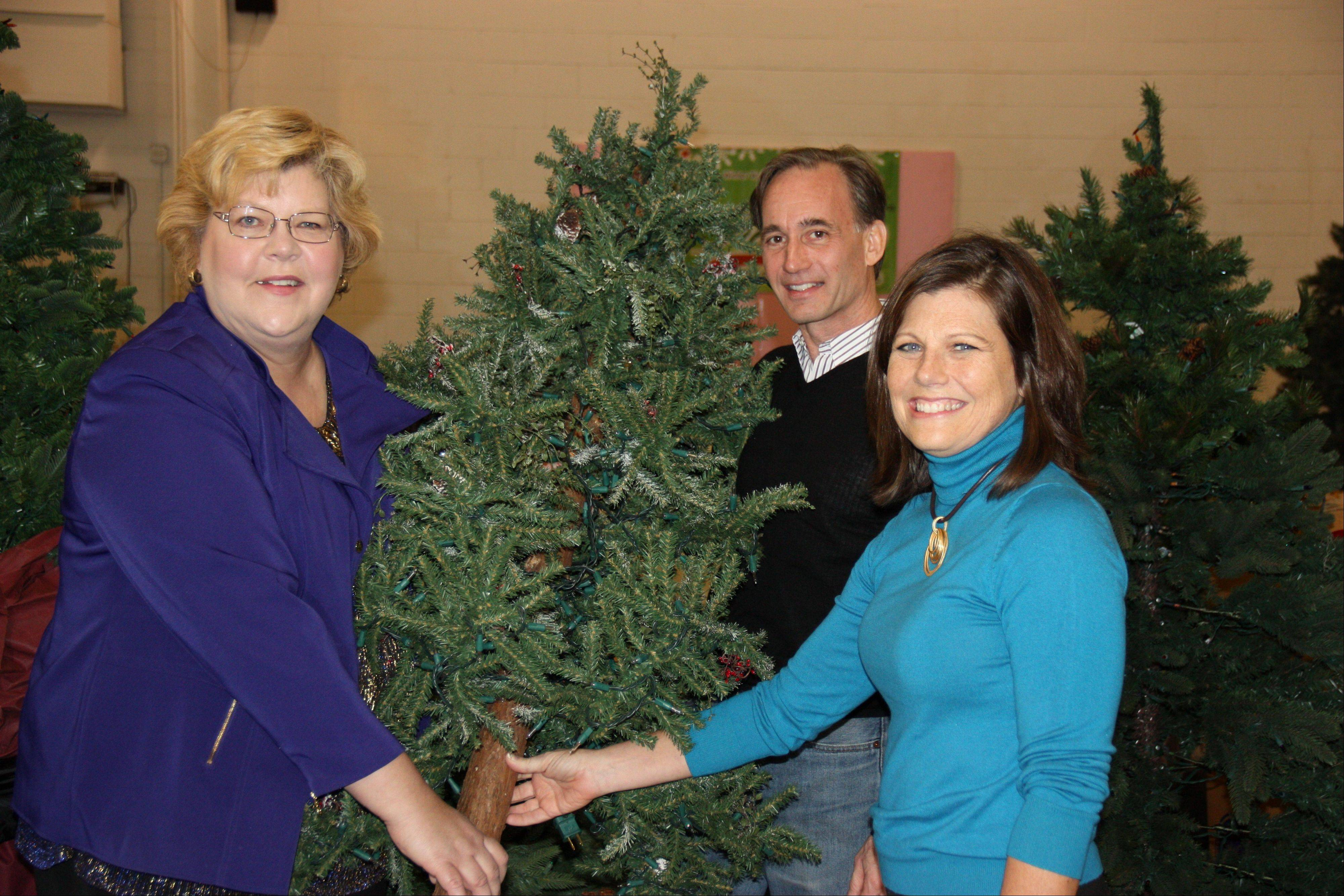 From left, Pat Boelter, chief marketing officer of Goodwill Industries of Metropolitan Chicago with Joe and Laurie Kane, owners of Treetime Christmas Creations.
