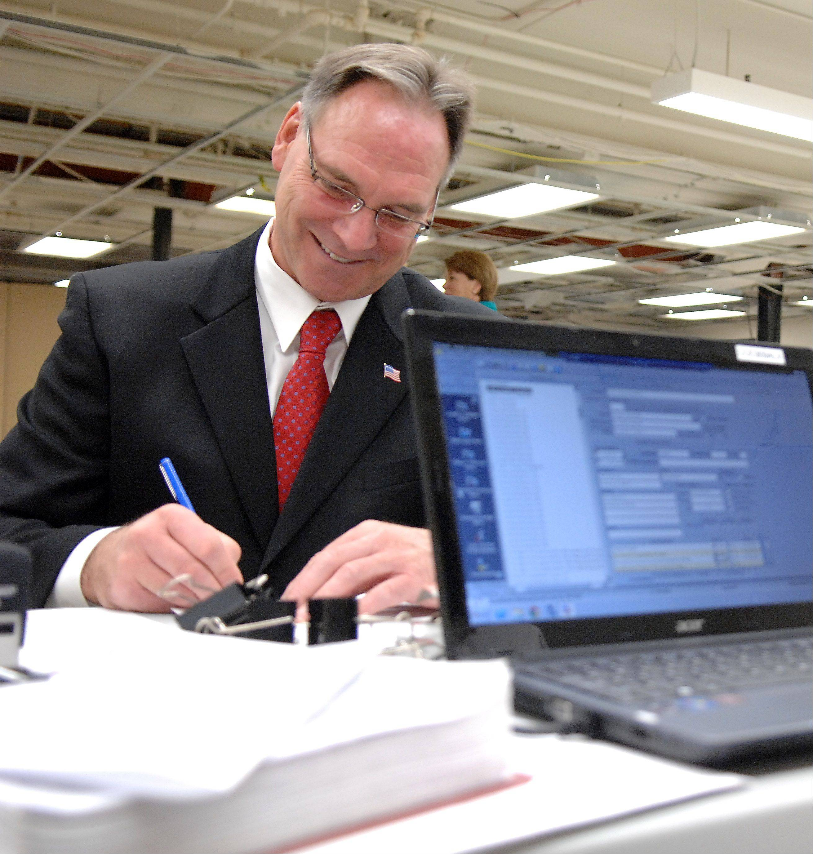 Kane County sheriff candidate Don Kramer files for the 2014 primary Monday at the clerk's office. Kramer is seeking the Republican nomination.