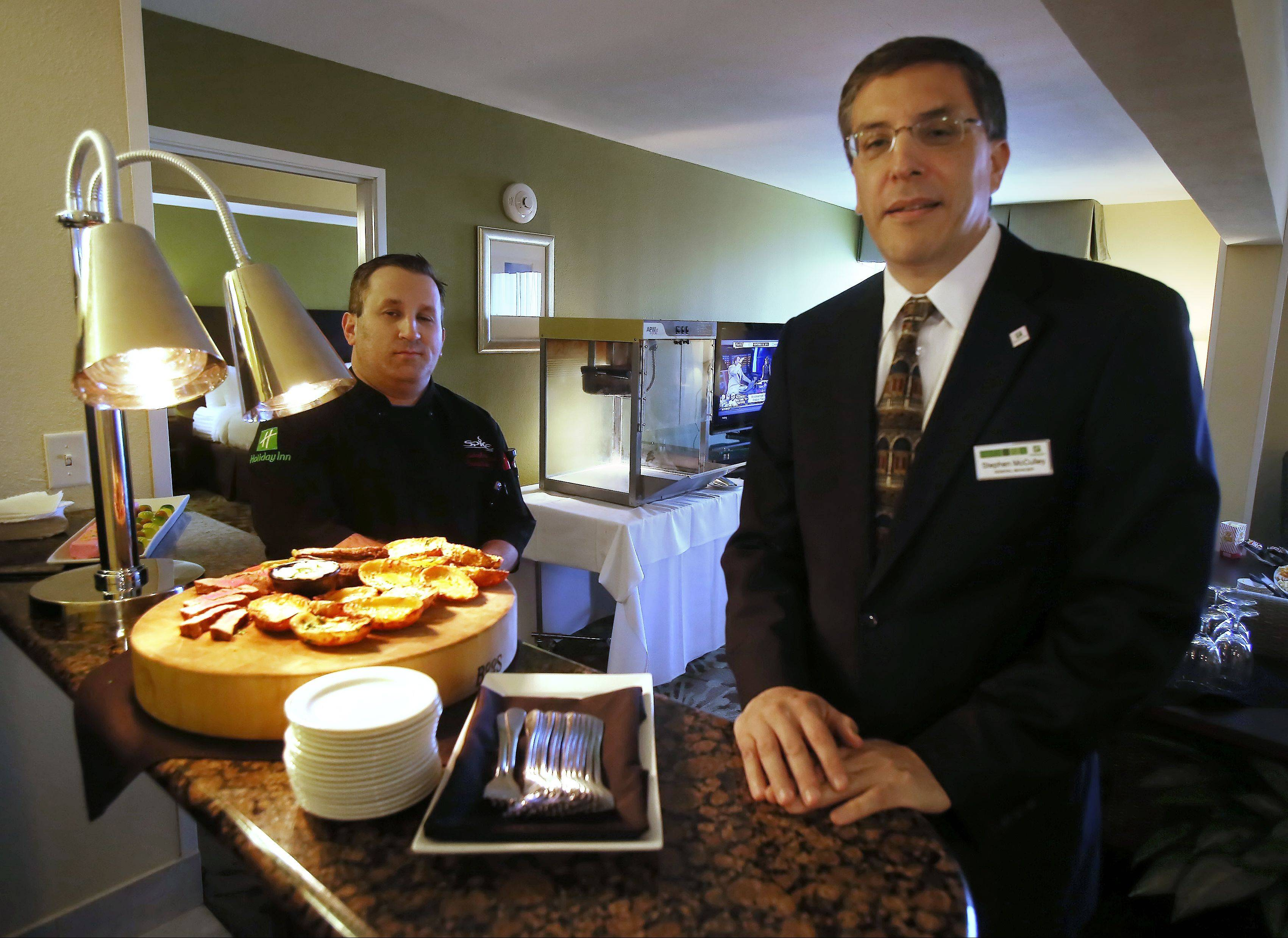 General manager Stephen McCulley, right, at the Holiday Inn Gurnee Convention Center looks forward to hosting 10 sailors from Great Lakes Naval Training Station for Thanksgiving Day. The sailors will be fed dinner and lighter fare prepared under the direction of executive chef Christopher Solare, and have use of this Presidential Suite during their stay.