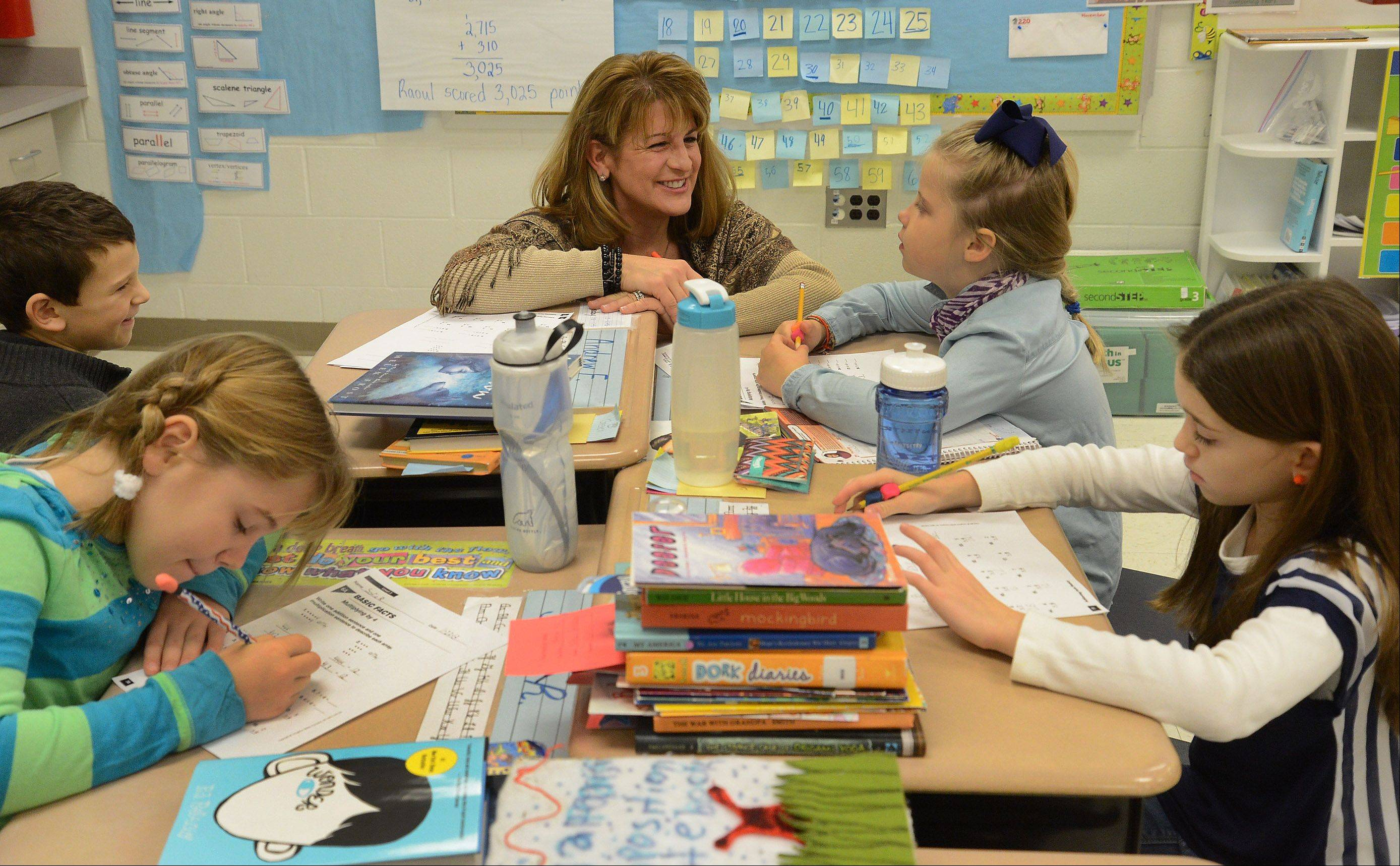 Lauren Gilleland works with her 3rd grade students at Roslyn Road Elementary School in Barrington, which won a National Blue Ribbon Award this year.