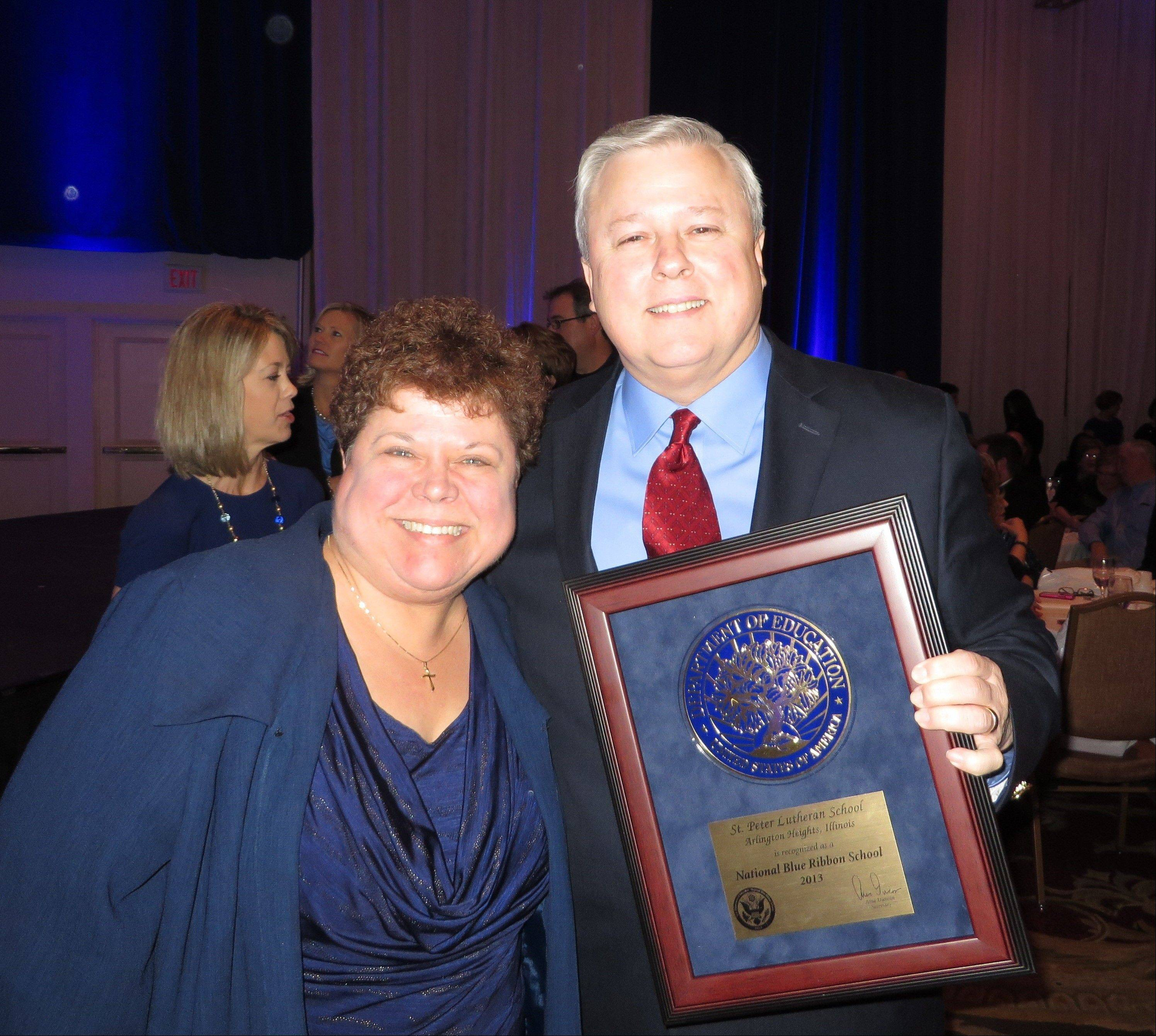 Julie Klopkie and Bruce Rudi, assistant principal and principal, respectively, of St. Peter Lutheran School in Arlington Heights, recently attended the award ceremony for this year's National Blue Ribbon schools. St. Peter was one of three Northwest Cook County schools to receive the honor.