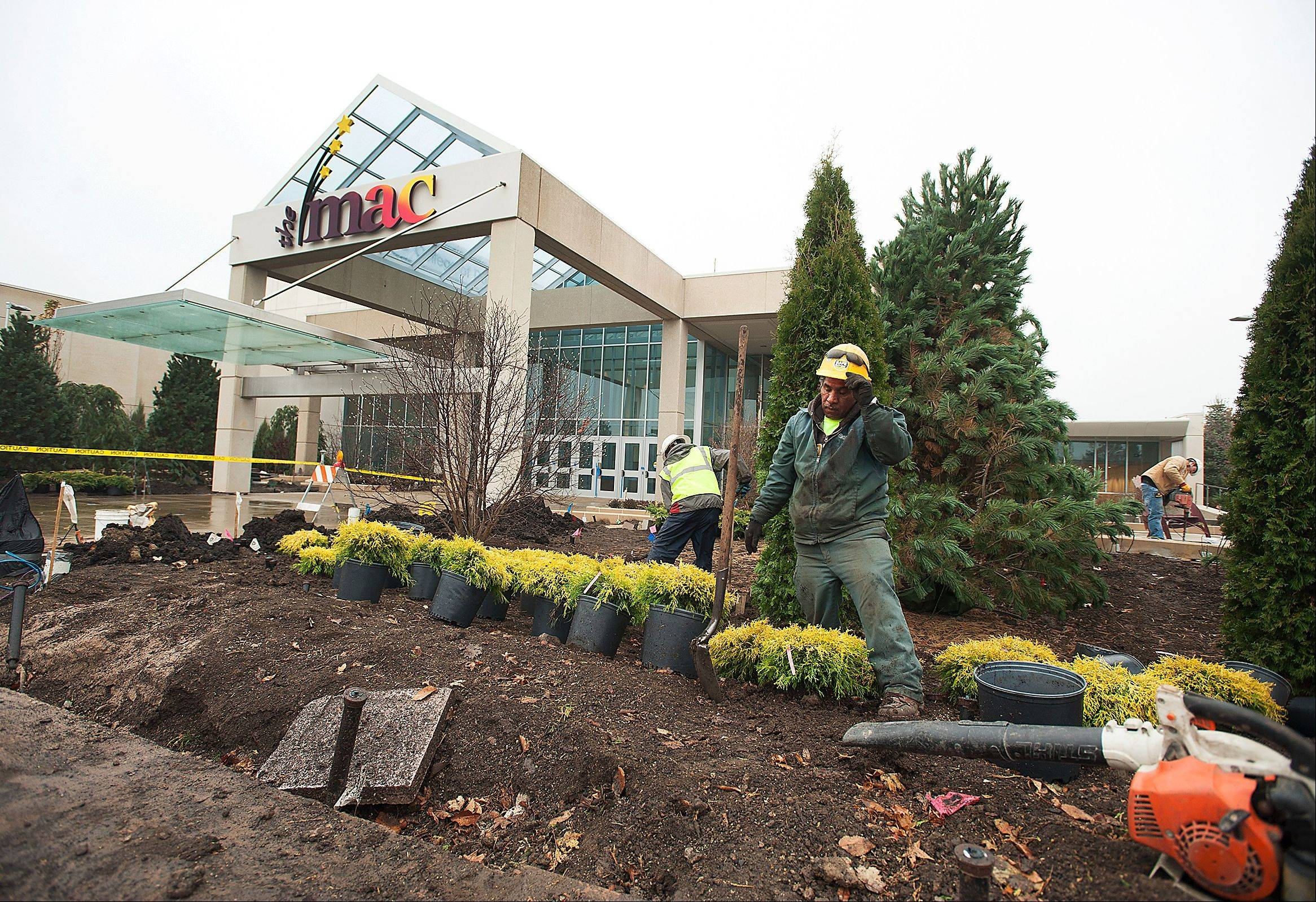 Crews install new landscaping in front of the McAninch Arts Center, which is scheduled to reopen in February after a 14-month, $35 million renovation project.