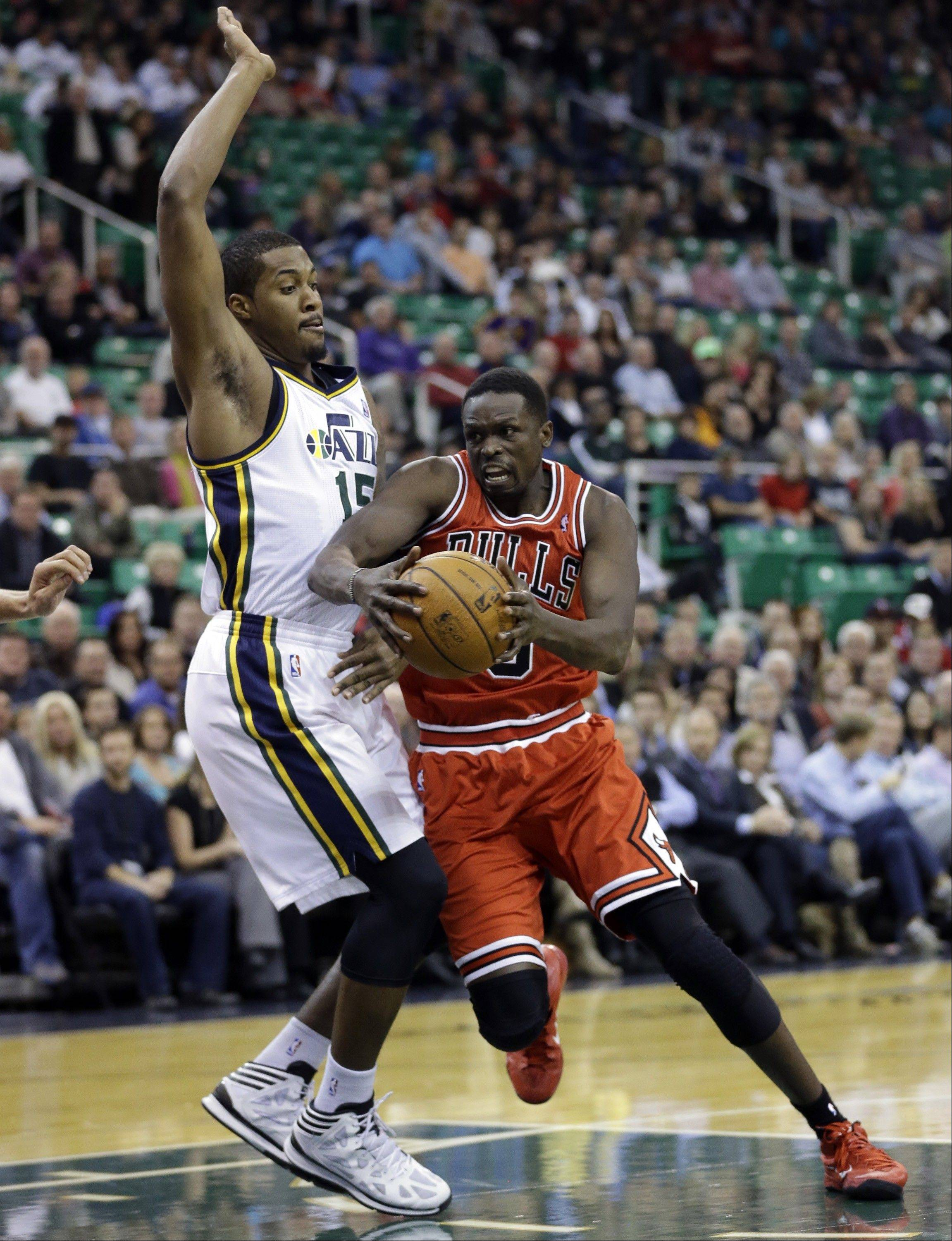 The Bulls' Luol Deng drives to the basket as Utah's Derrick Favors defends in the first quarter Monday night.