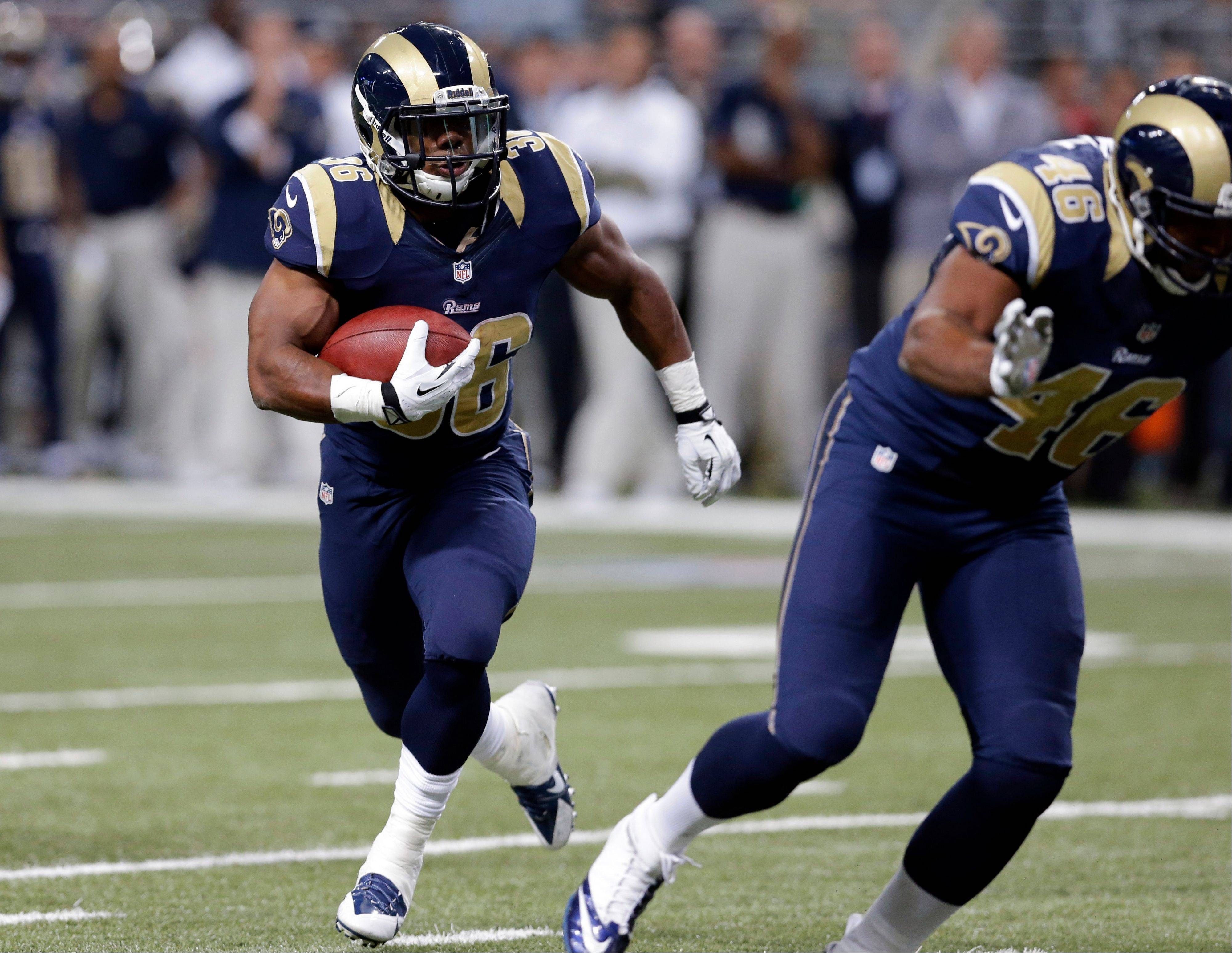 St. Louis Rams running back Benny Cunningham heads to the end zone for a 9-yard touchdown run in the fourth quarter Sunday against a Bears defense that allowed 258 yards rushing.