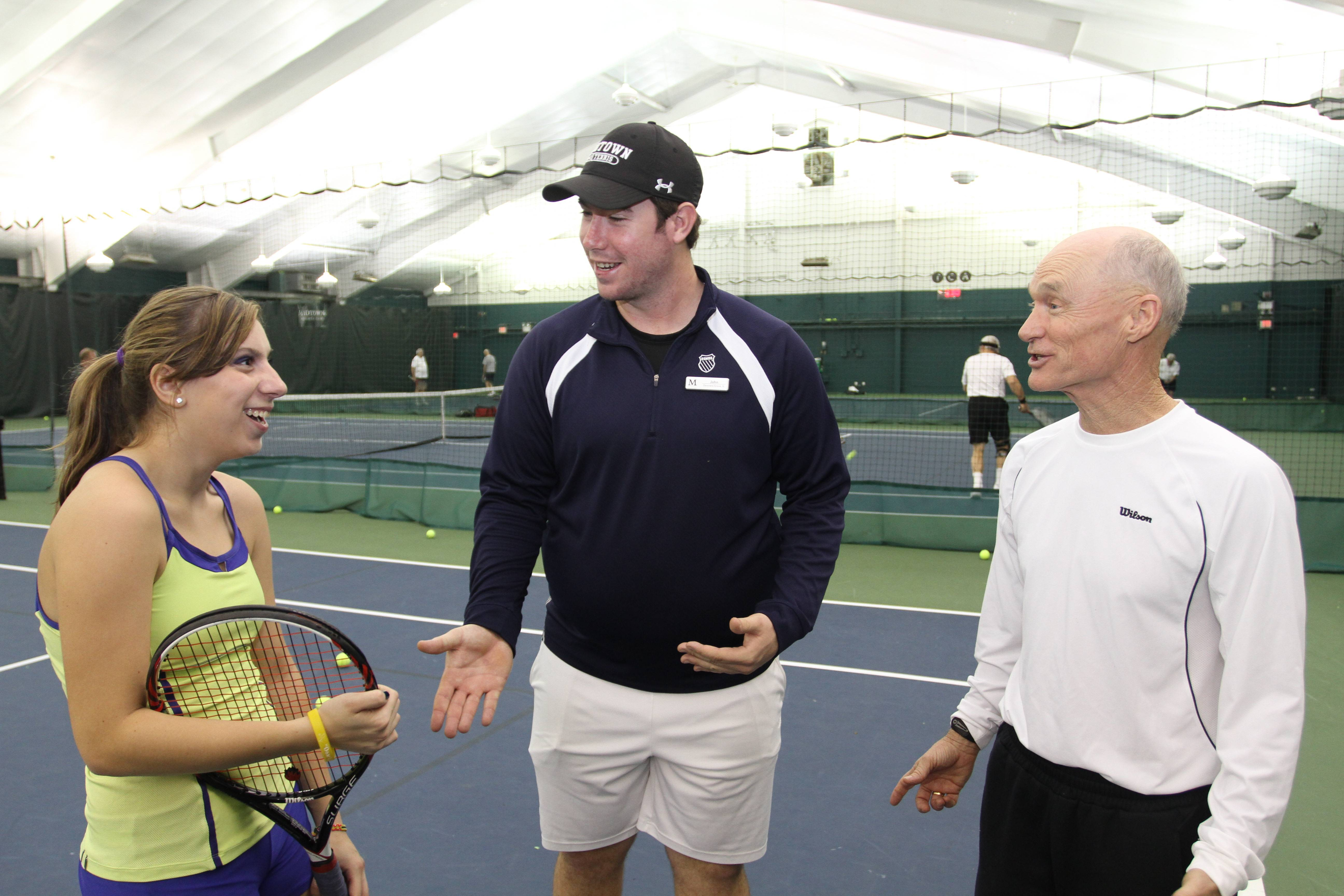Midtown Athletic Club Willowbrook Tennis Director Randy Paisley (right) shares a laugh with tennis coach John Irish and Midtown member Emily Binder of Downers Grove.